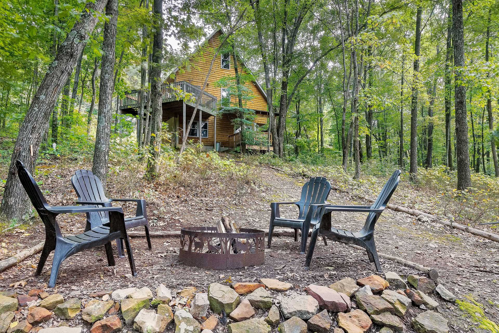Secluded in the woods and surrounded by natural beauty, this home has it all.
