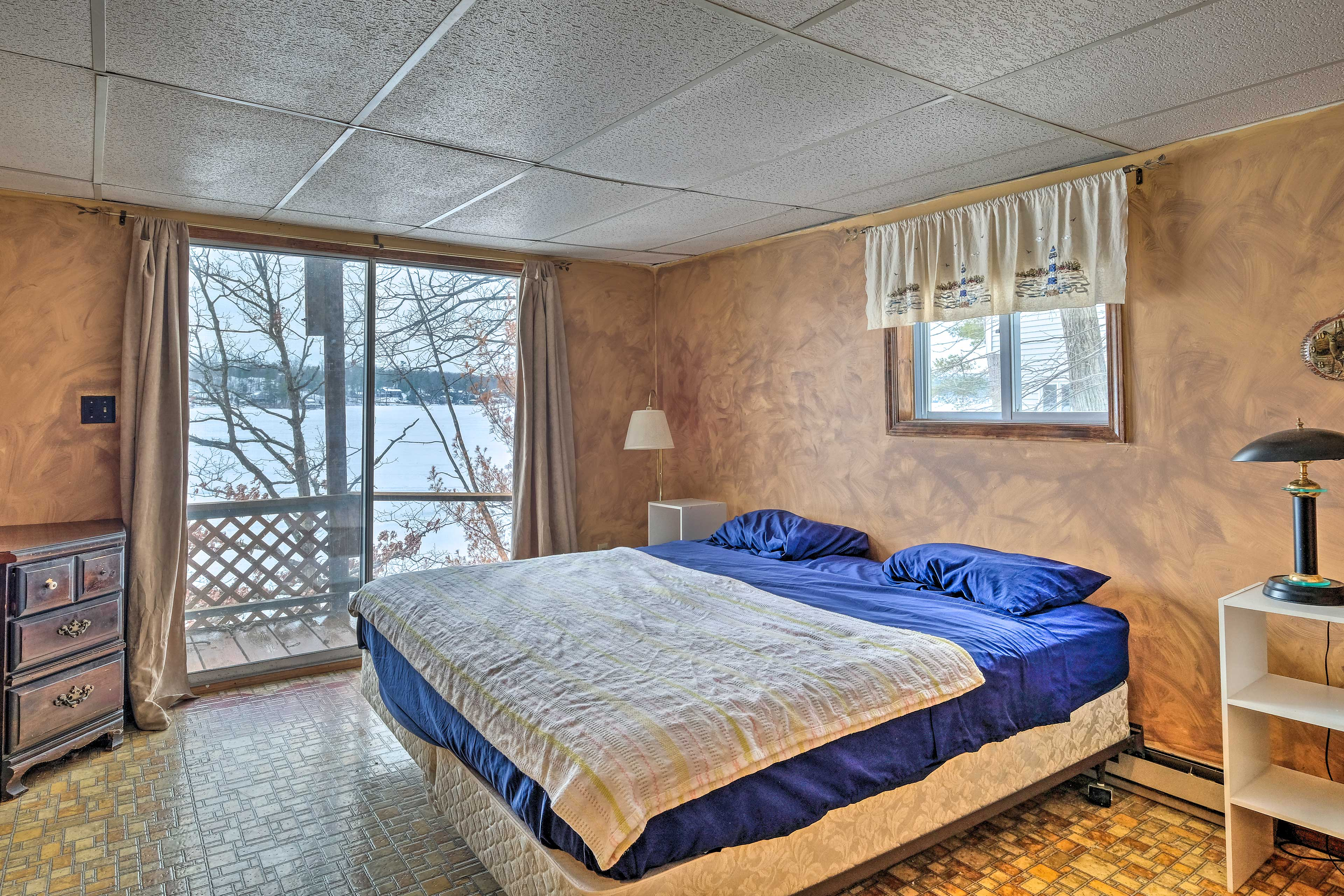 Wake up the views of Glen Lake each morning from this room's king bed.