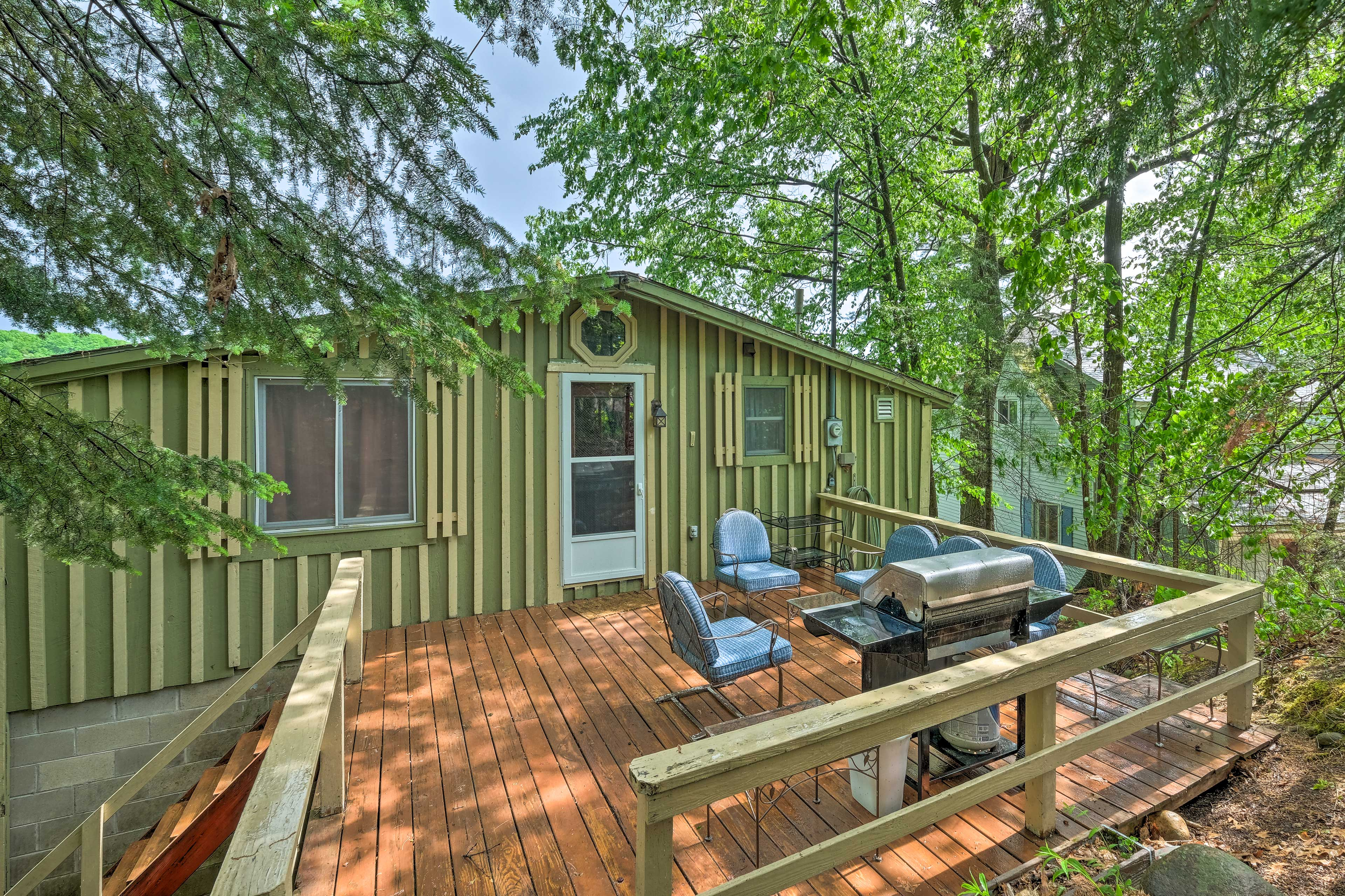 The Queensbury vacation rental features multiple outdoor living spaces.