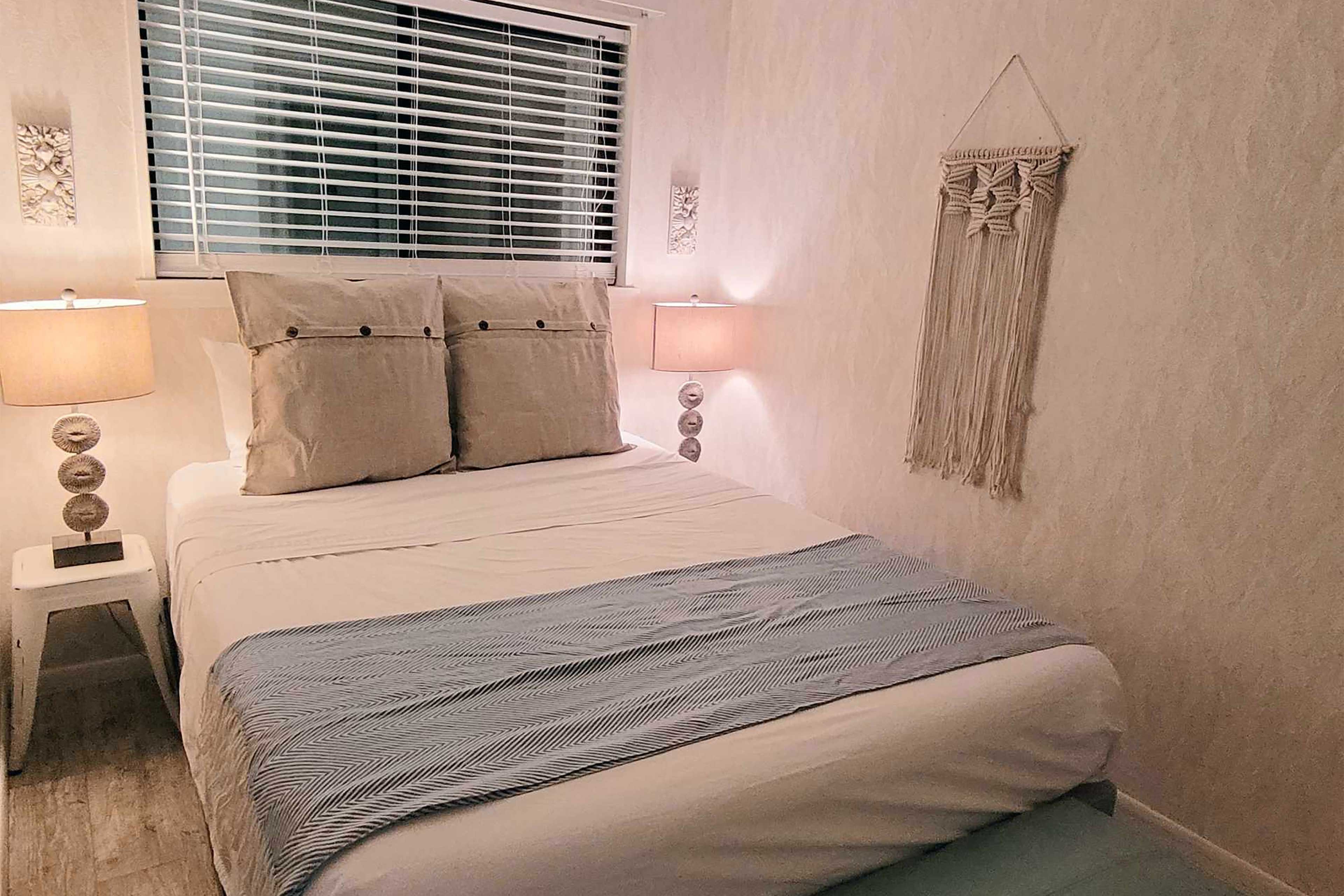 The bedroom boasts a queen bed.