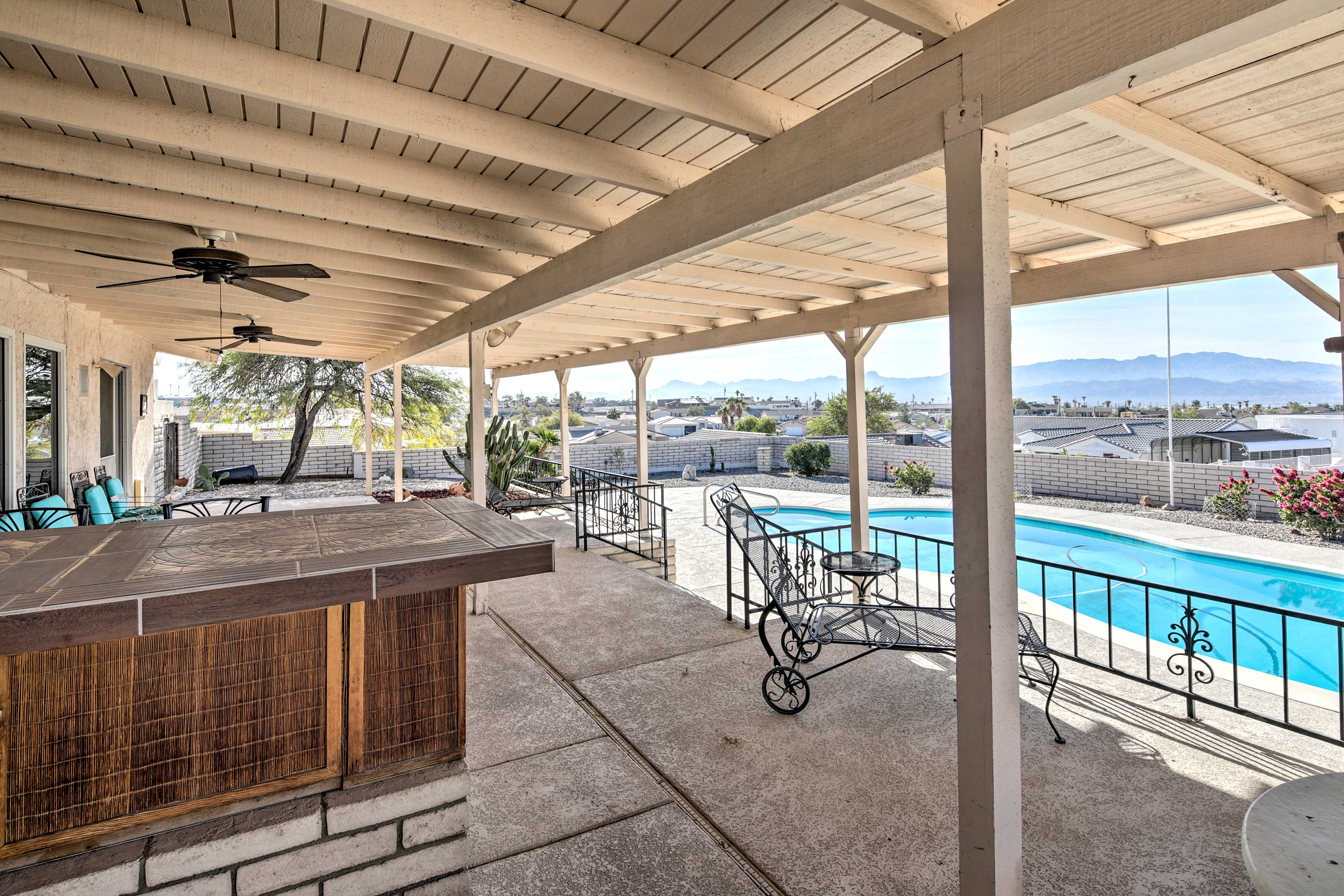 This covered patio is sure to impress with its views and ample seating.