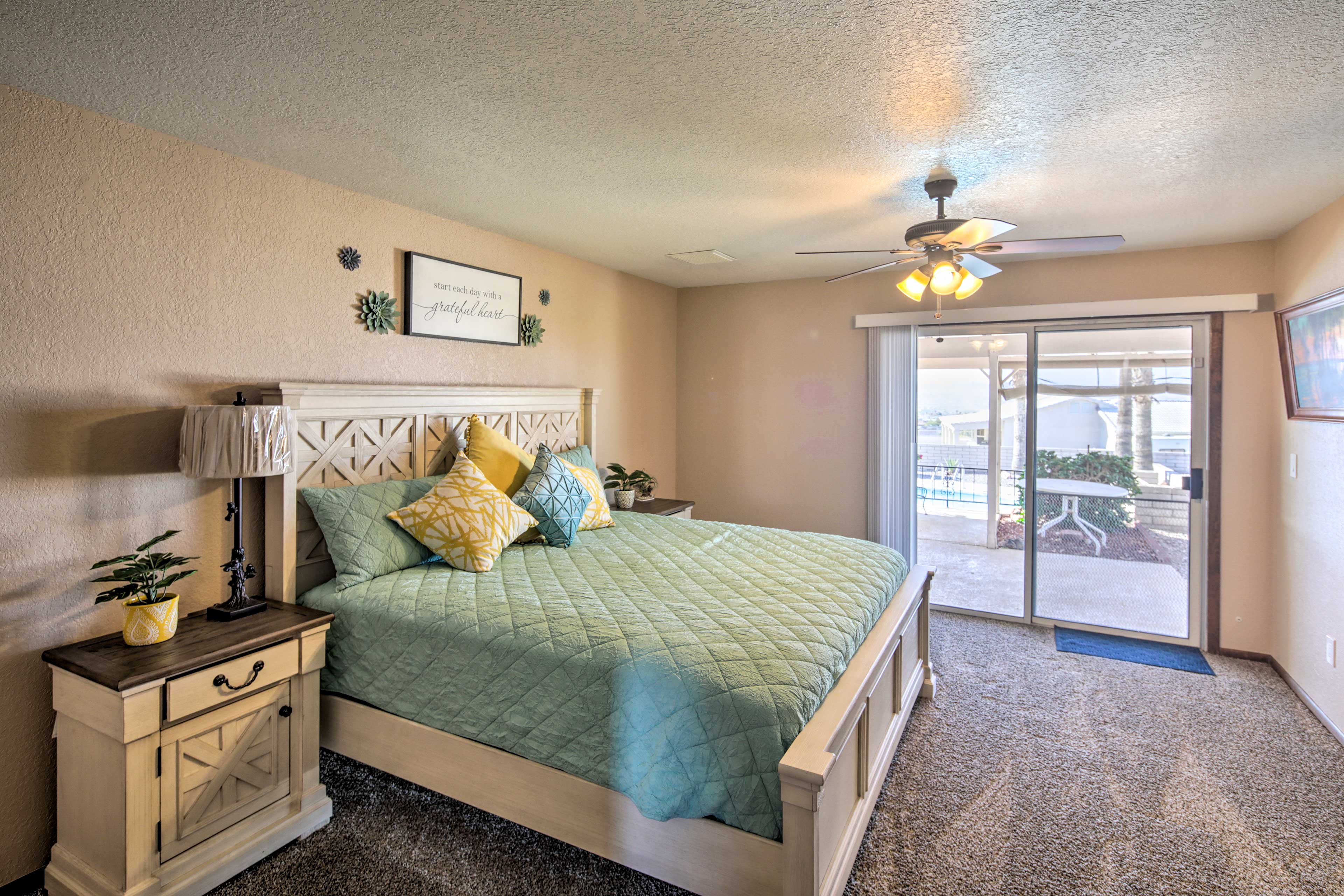 Claim this rejuvenating master bedroom as your own.