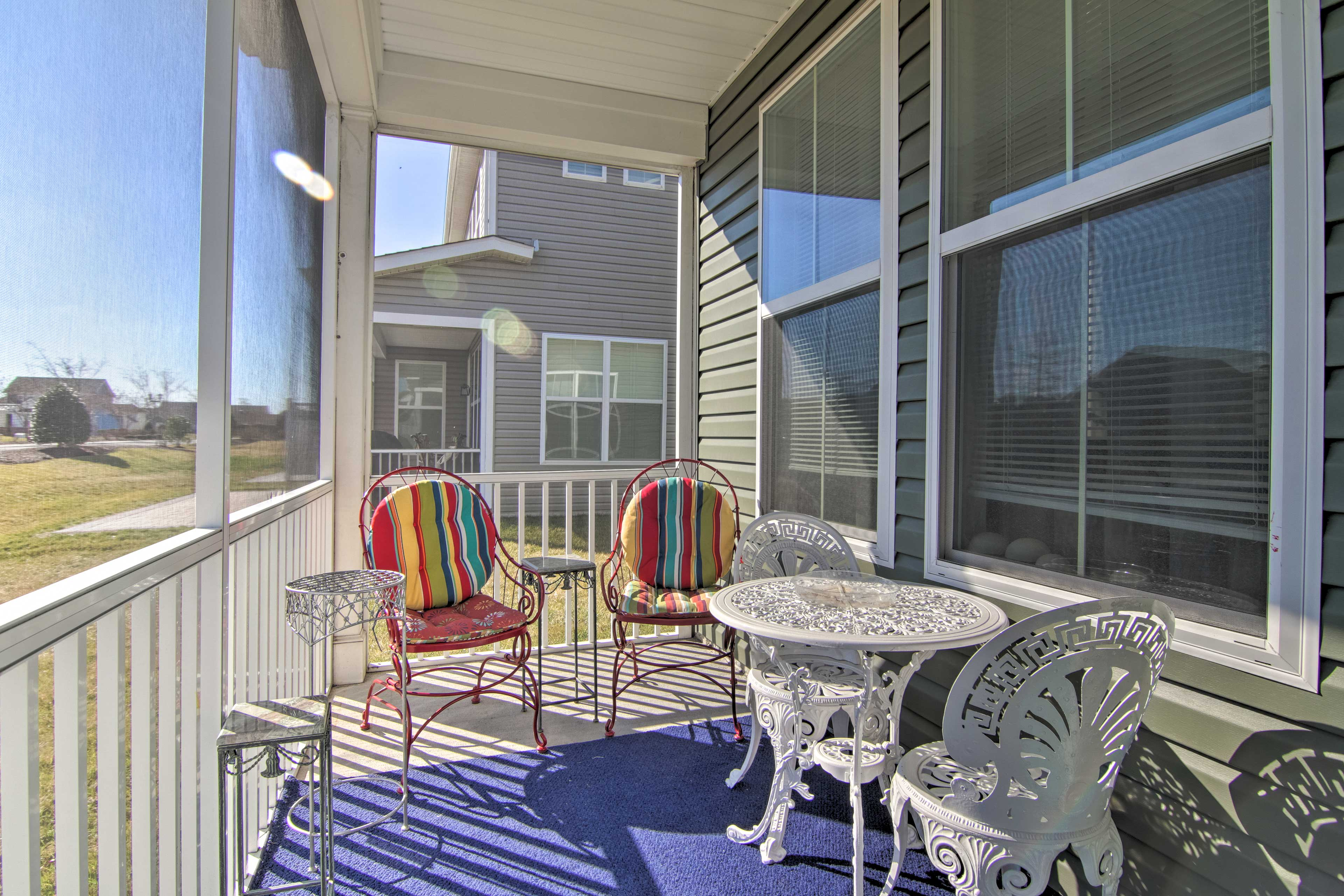 Enjoy a snack or a drink out on the screened-in porch.