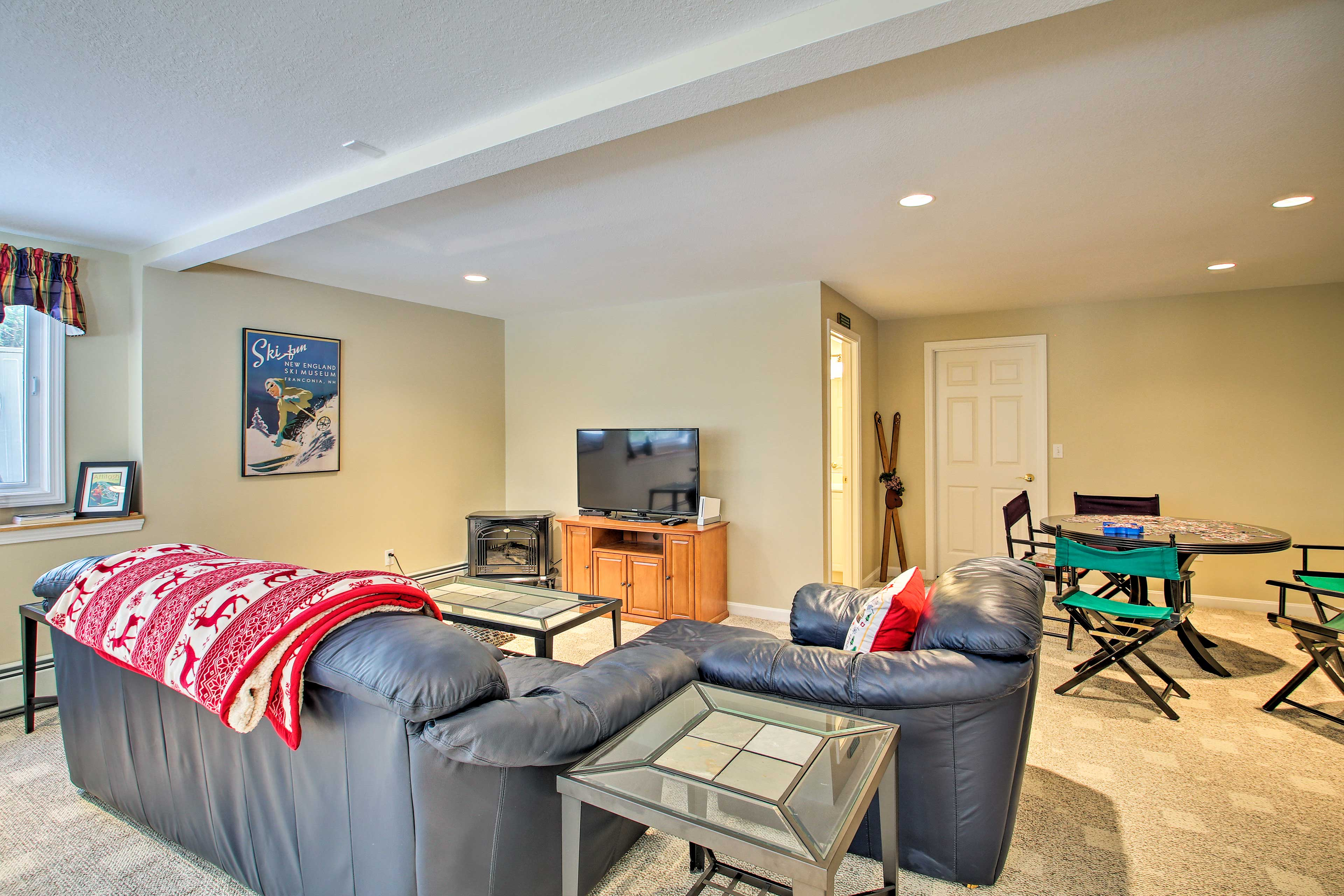 The game room features a pool table, card table, and a dartboard!
