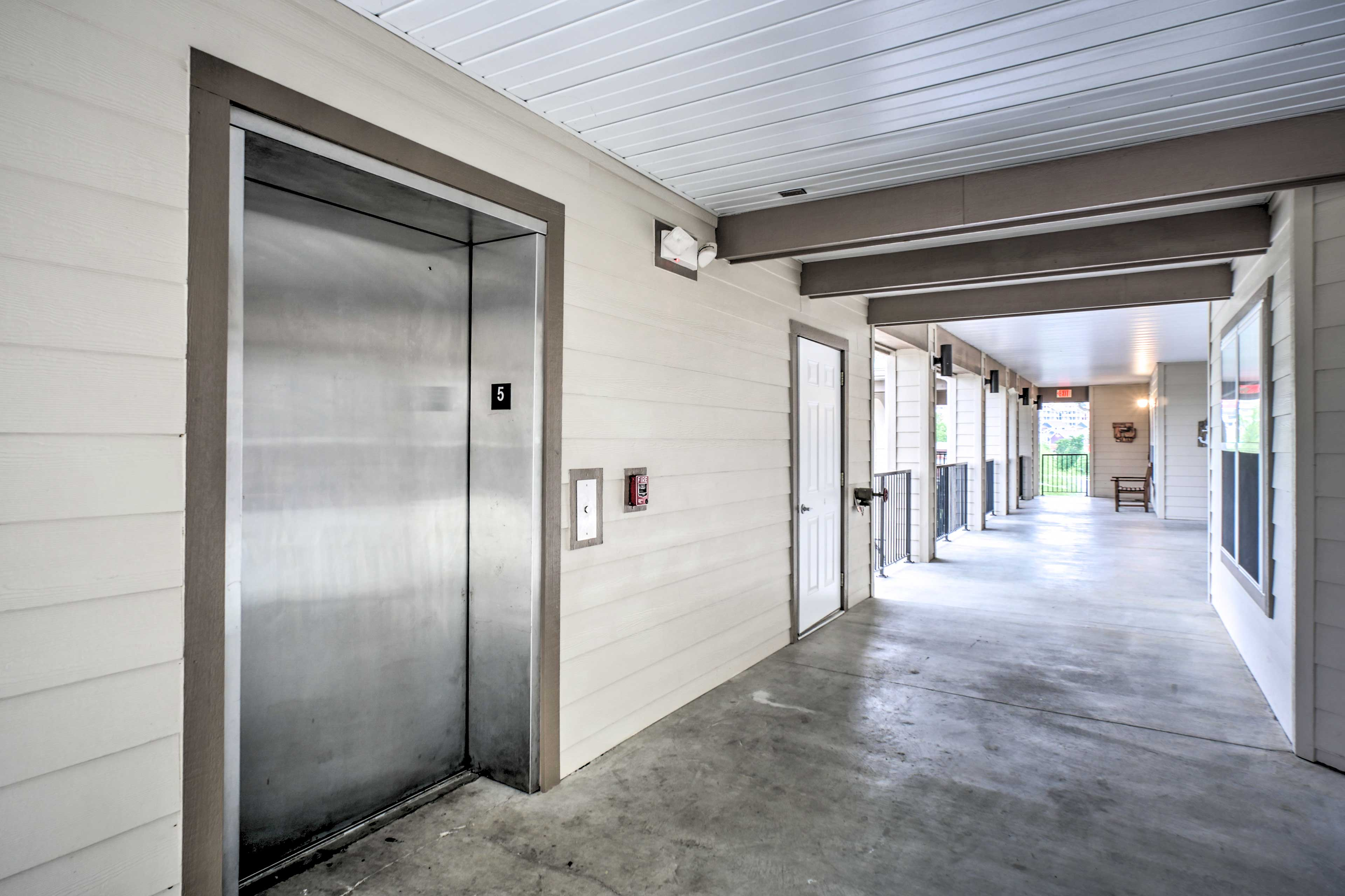 This resort complex has elevators for guests to access the 5th floor condo.