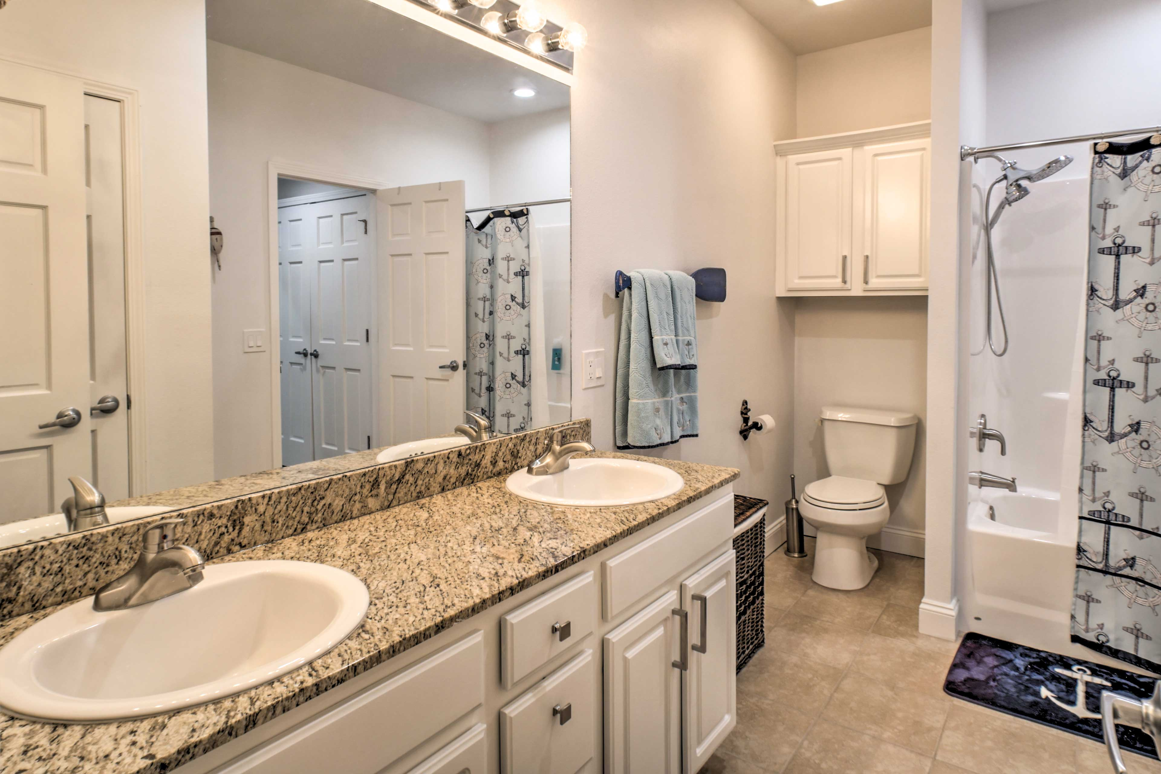 The second ensuite bathroom features dual sinks and a shower/tub combo.
