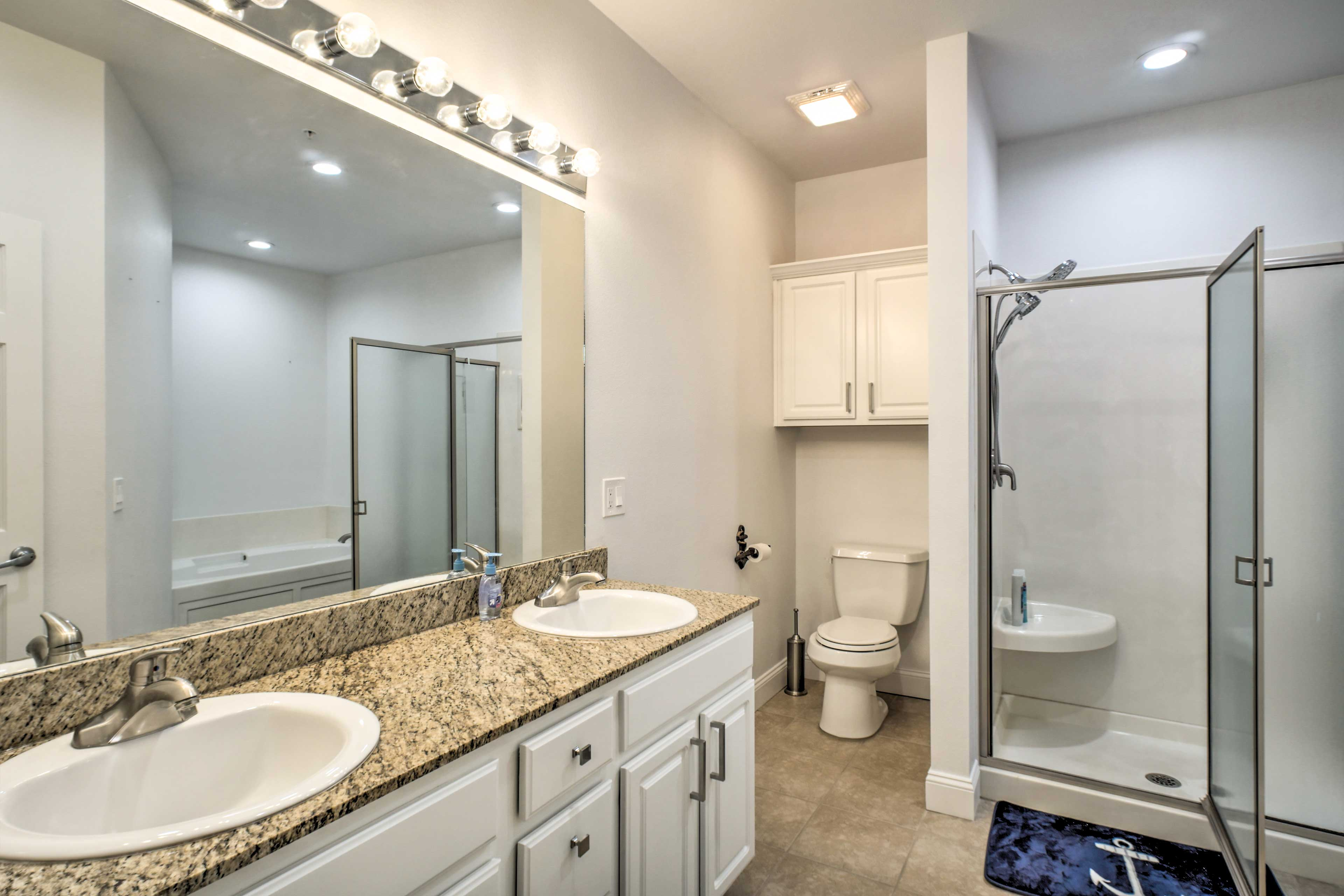 Step into the ensuite master bathroom and take a steamy shower.
