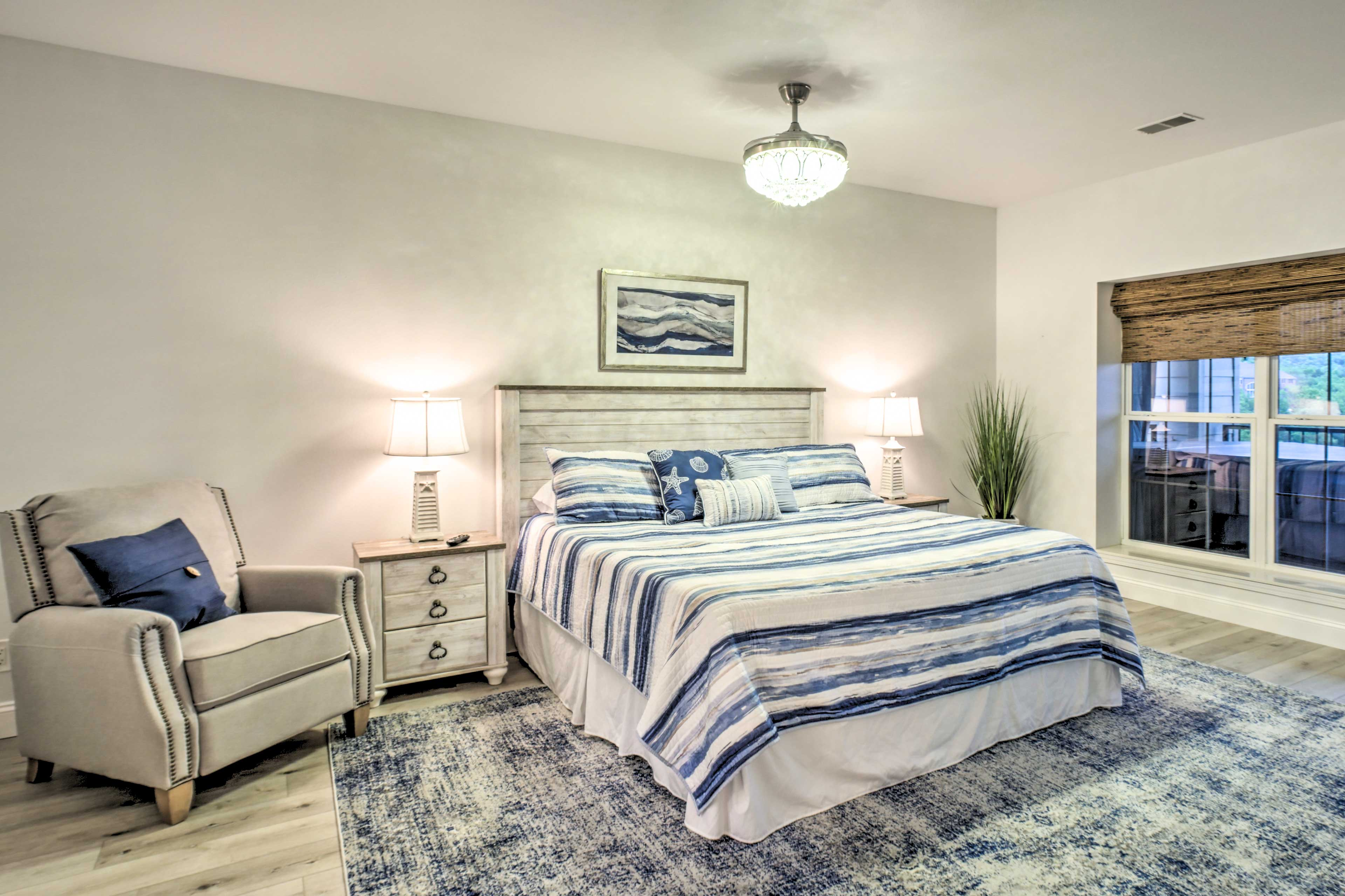 Step into the spacious master bedroom and fall asleep in the king-sized bed.