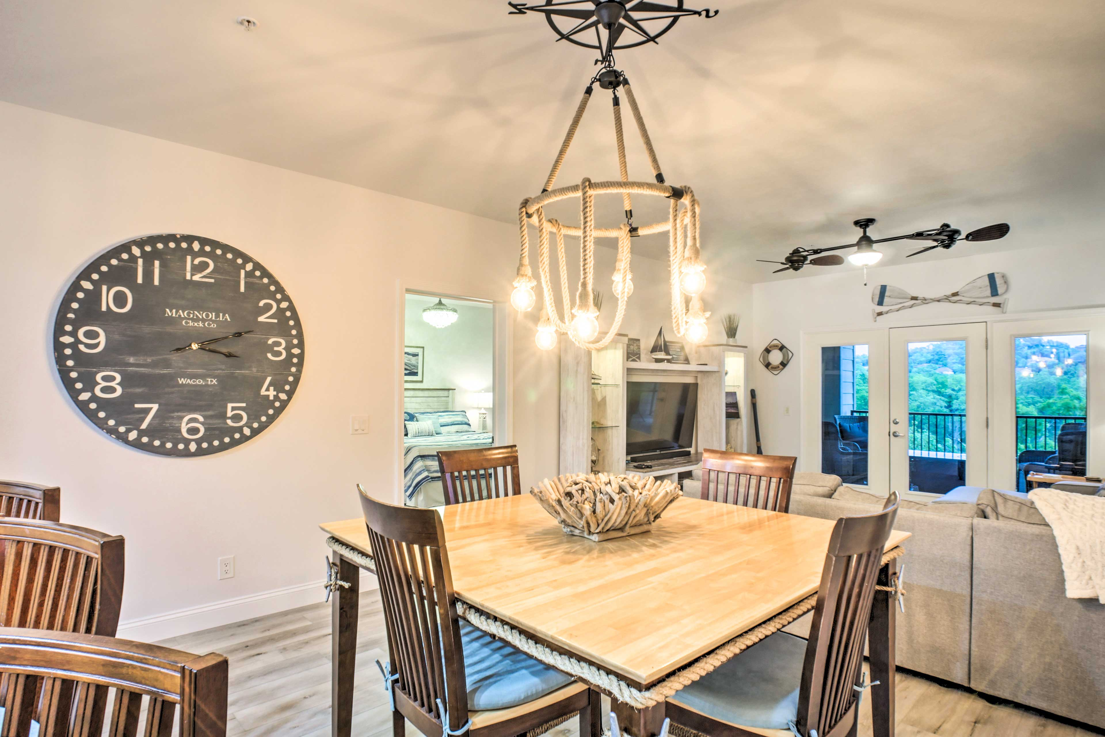 Enjoy tasteful touches such as this marine-style chandelier.