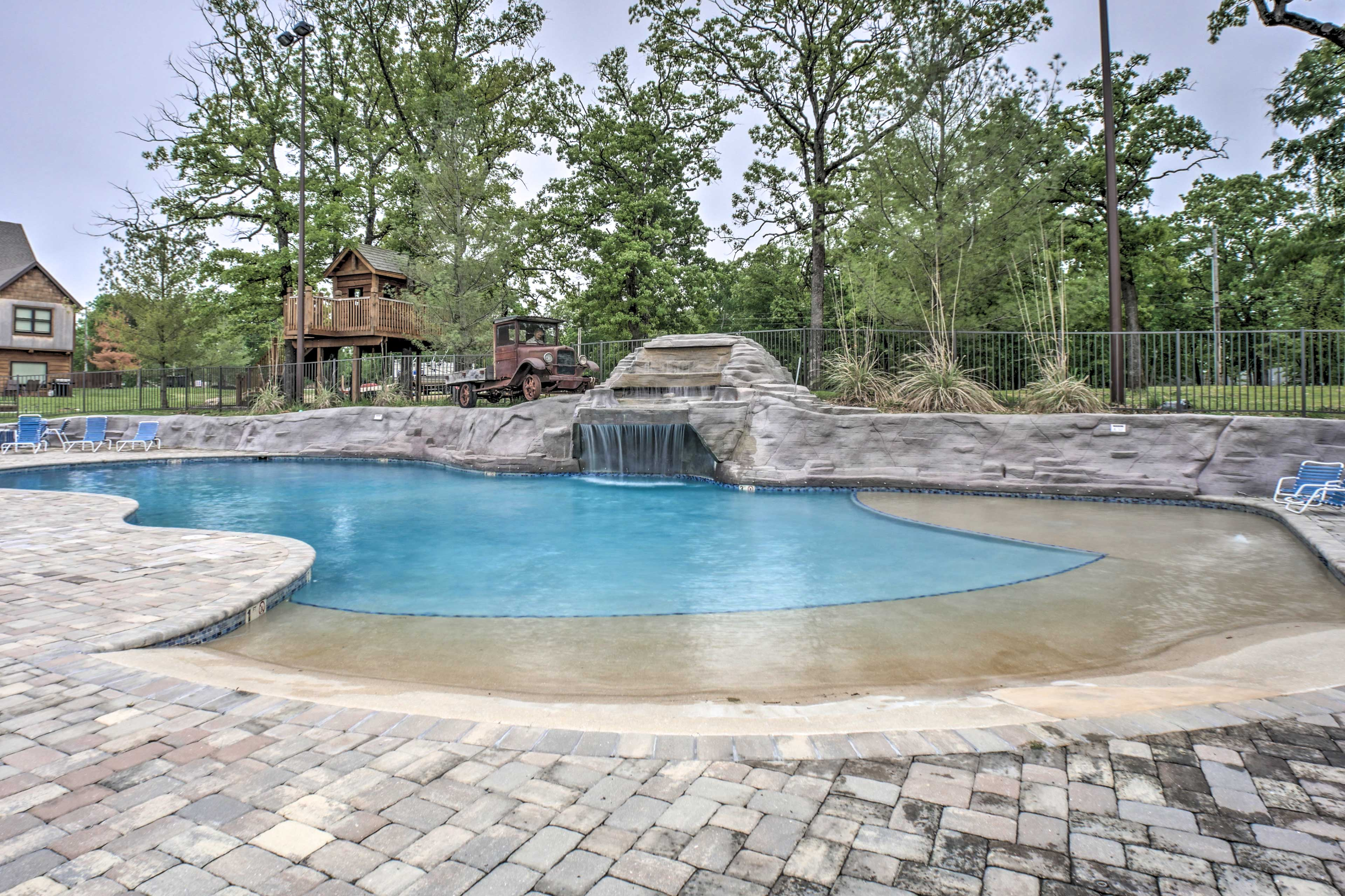 Let kids splash in the pool with a water feature.