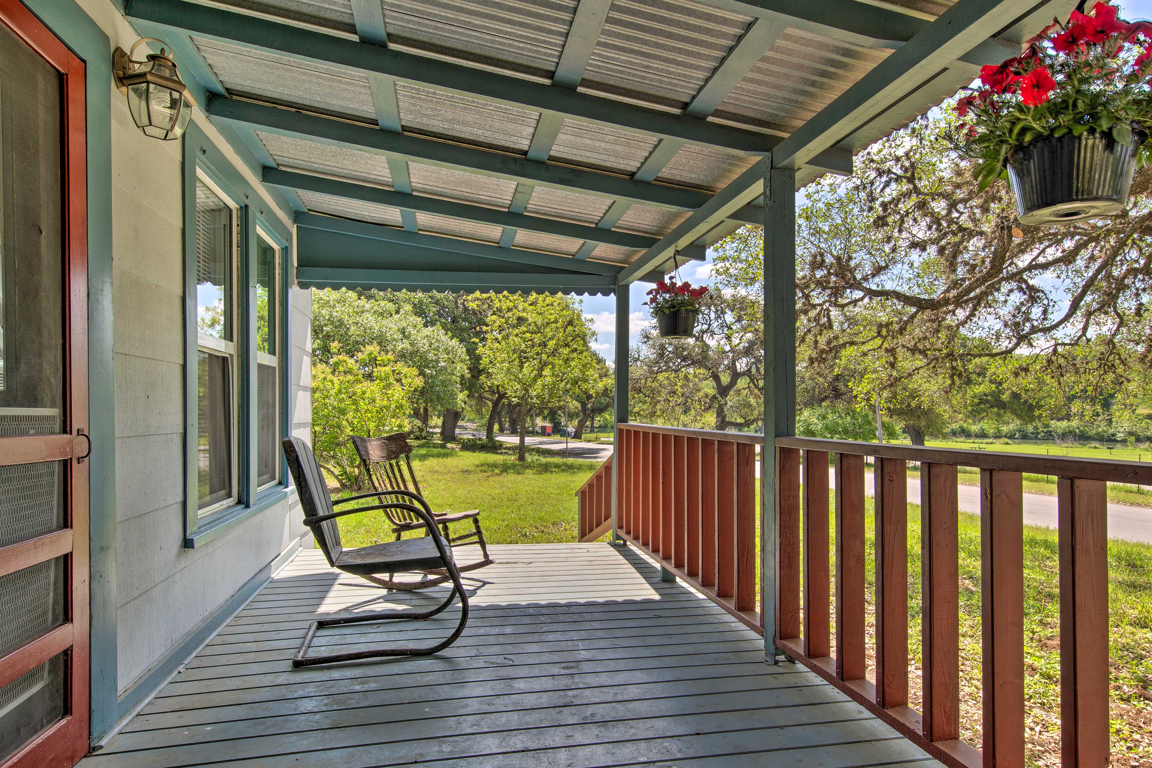 Watch the world pass by from the comfort of this shaded deck.