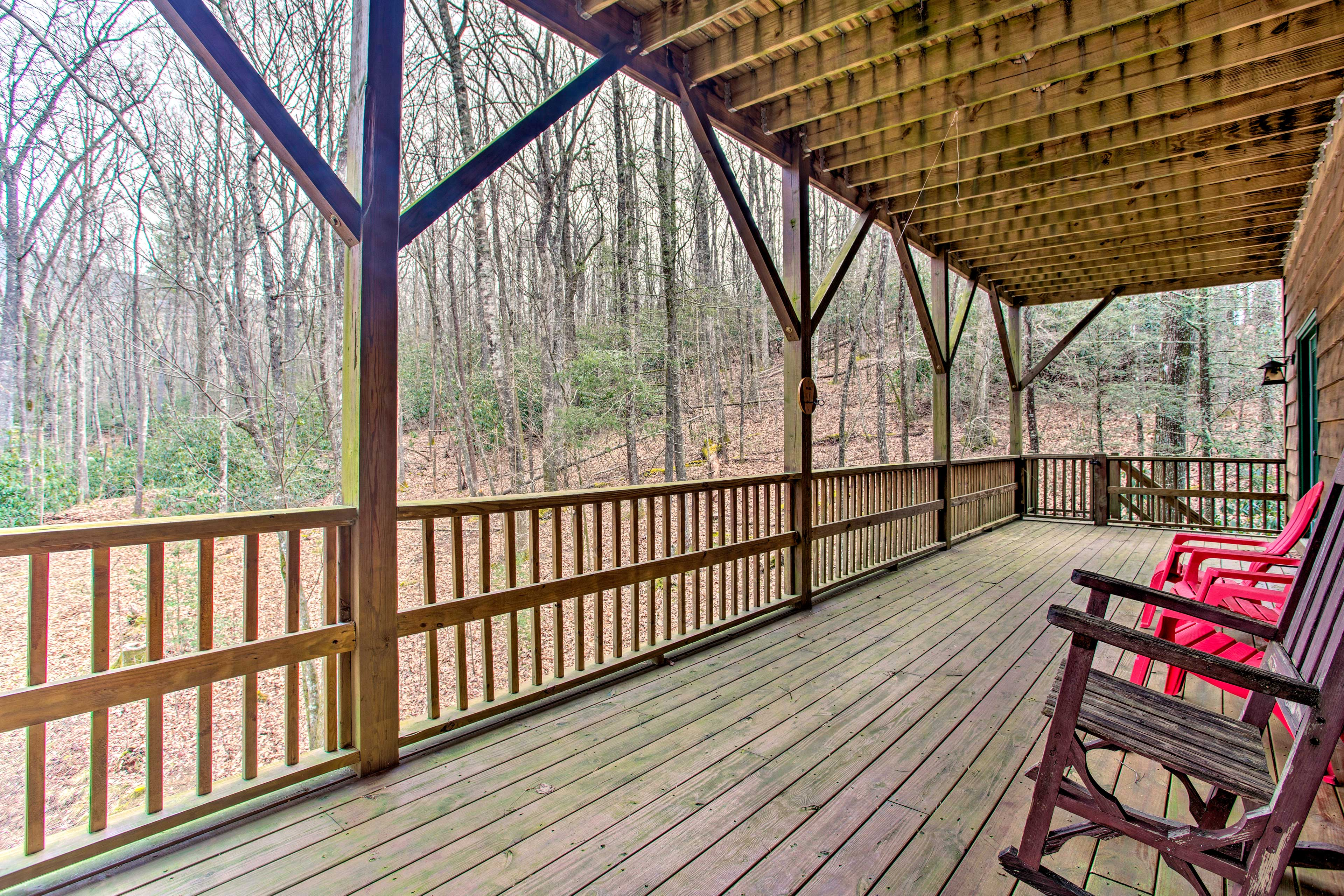 Admire the forest and mountain views from this expansive deck.
