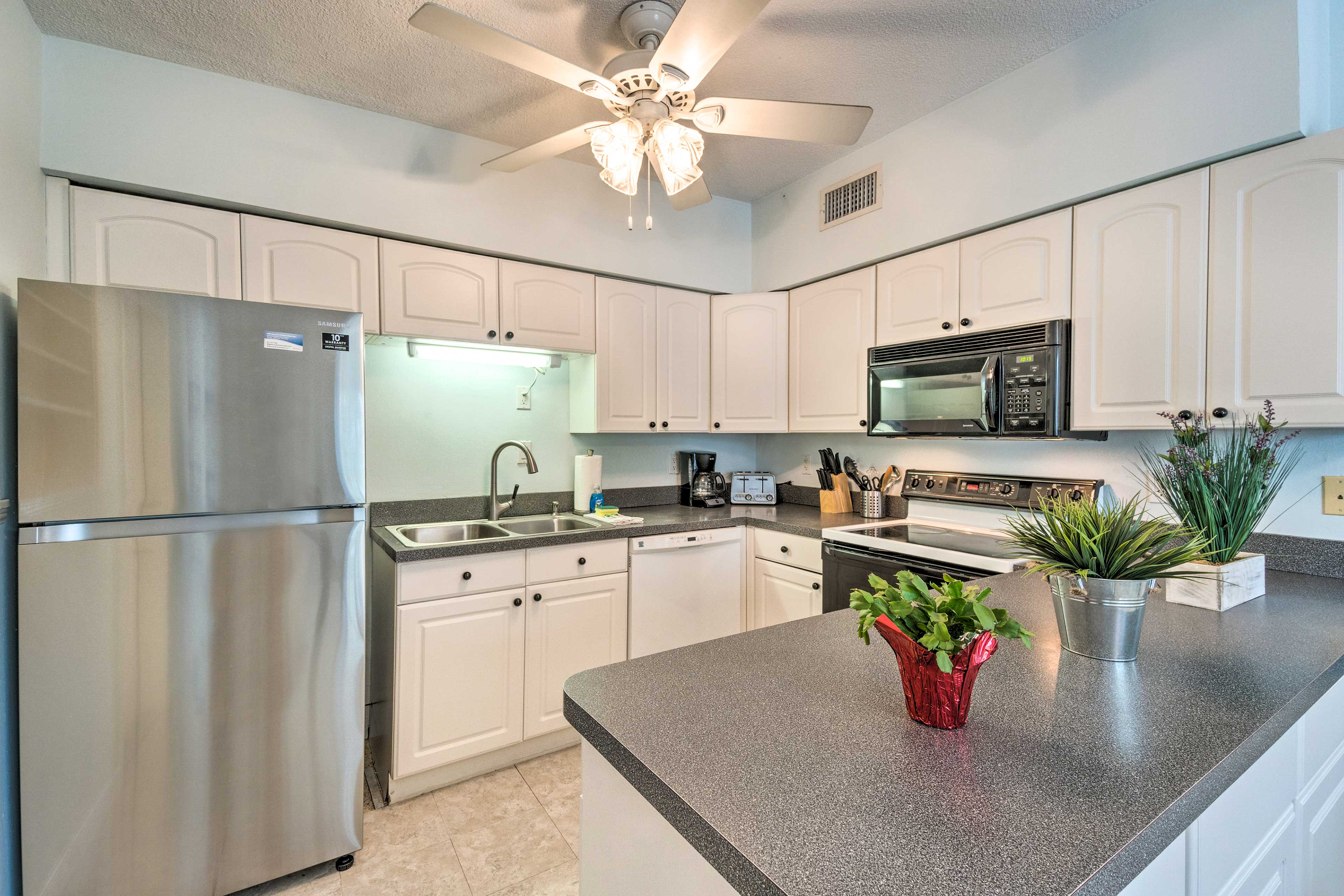 The kitchen comes fully equipped with updated appliances.