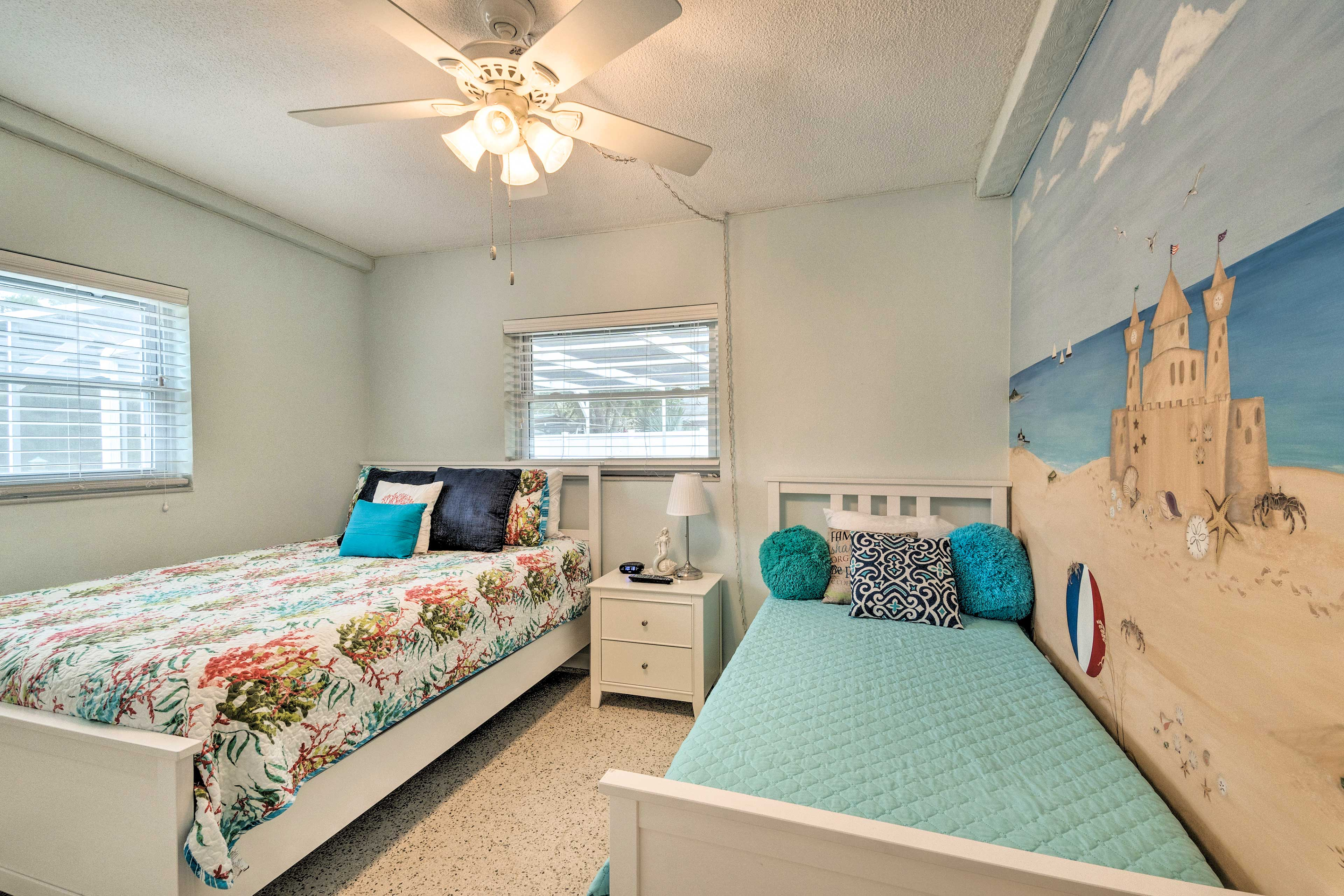 This second bedroom features a queen and twin bed.