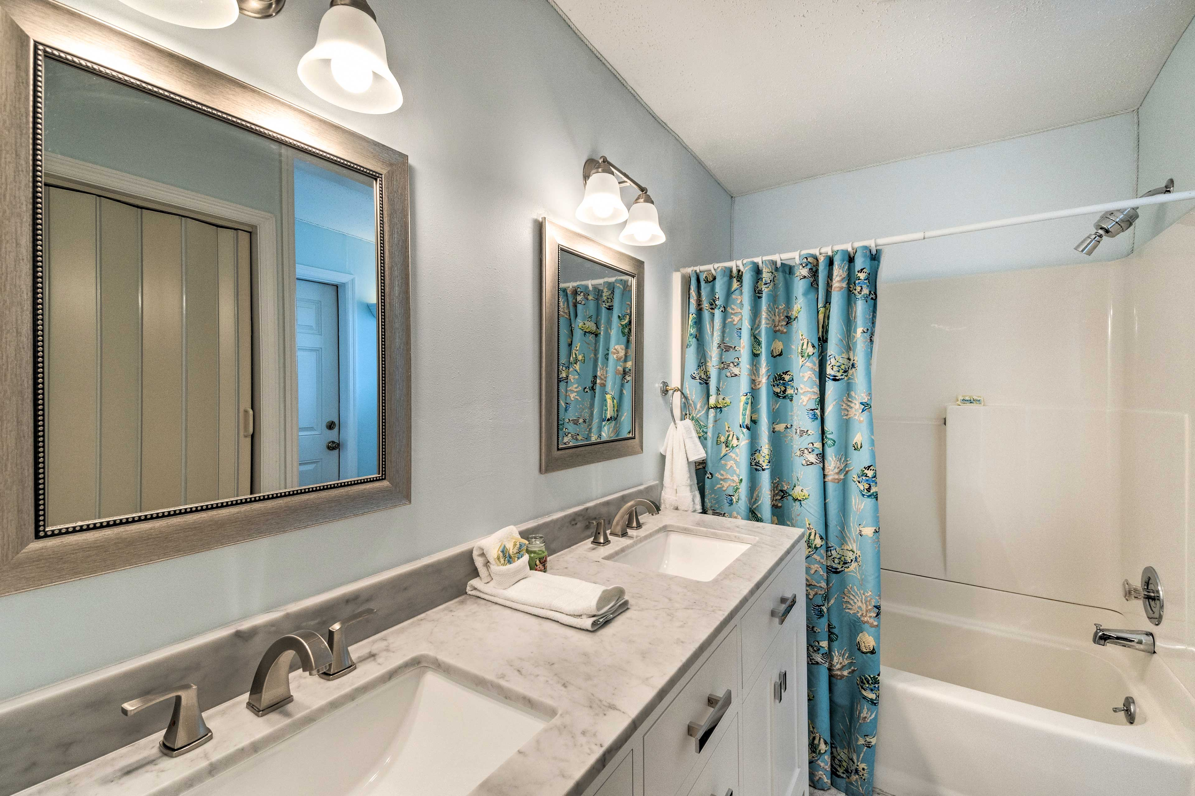 Dual sinks and a shower/tub combo highlight the master bath.