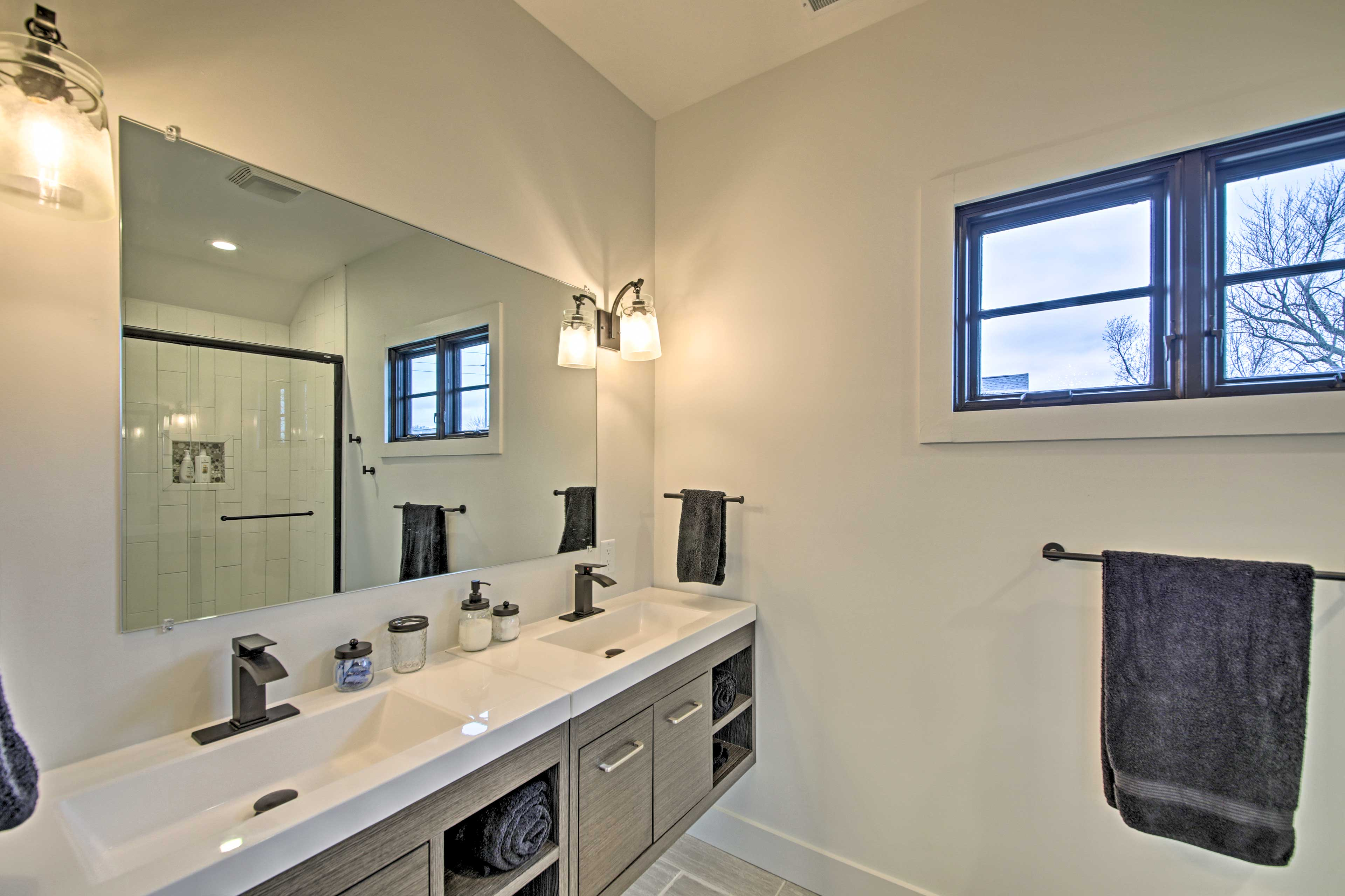 Get ready for the day at the bright bathroom vanity.