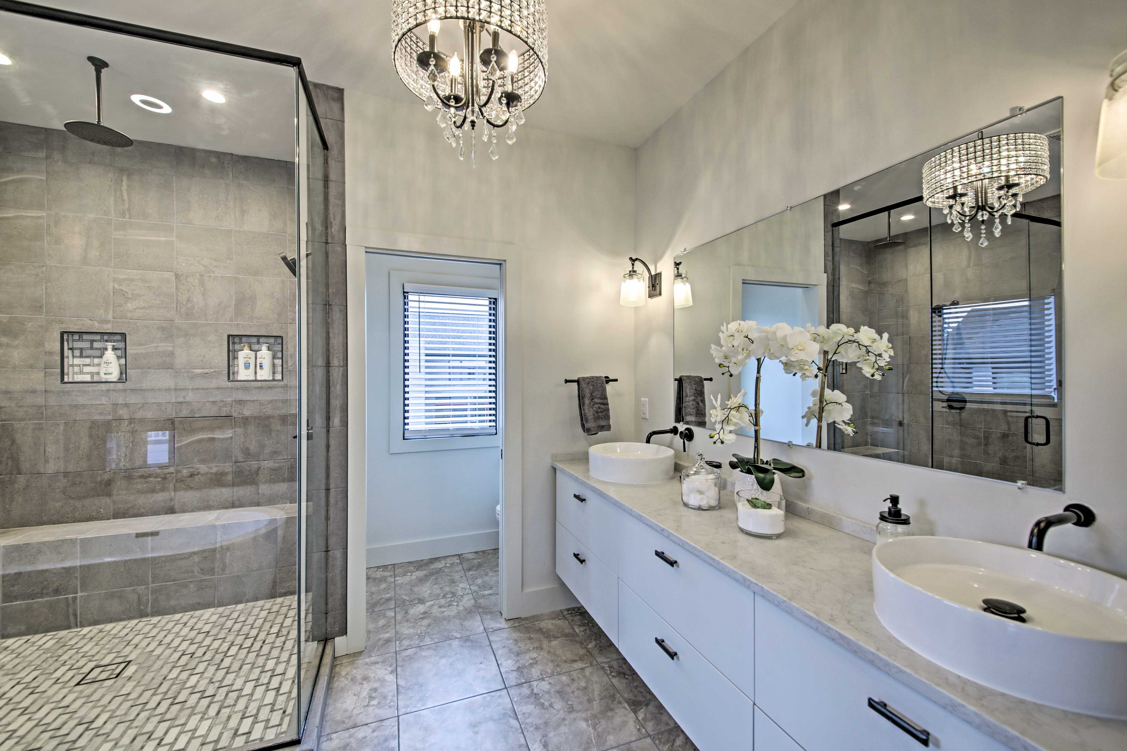 Enjoy your morning routine in this luxurious bathroom.