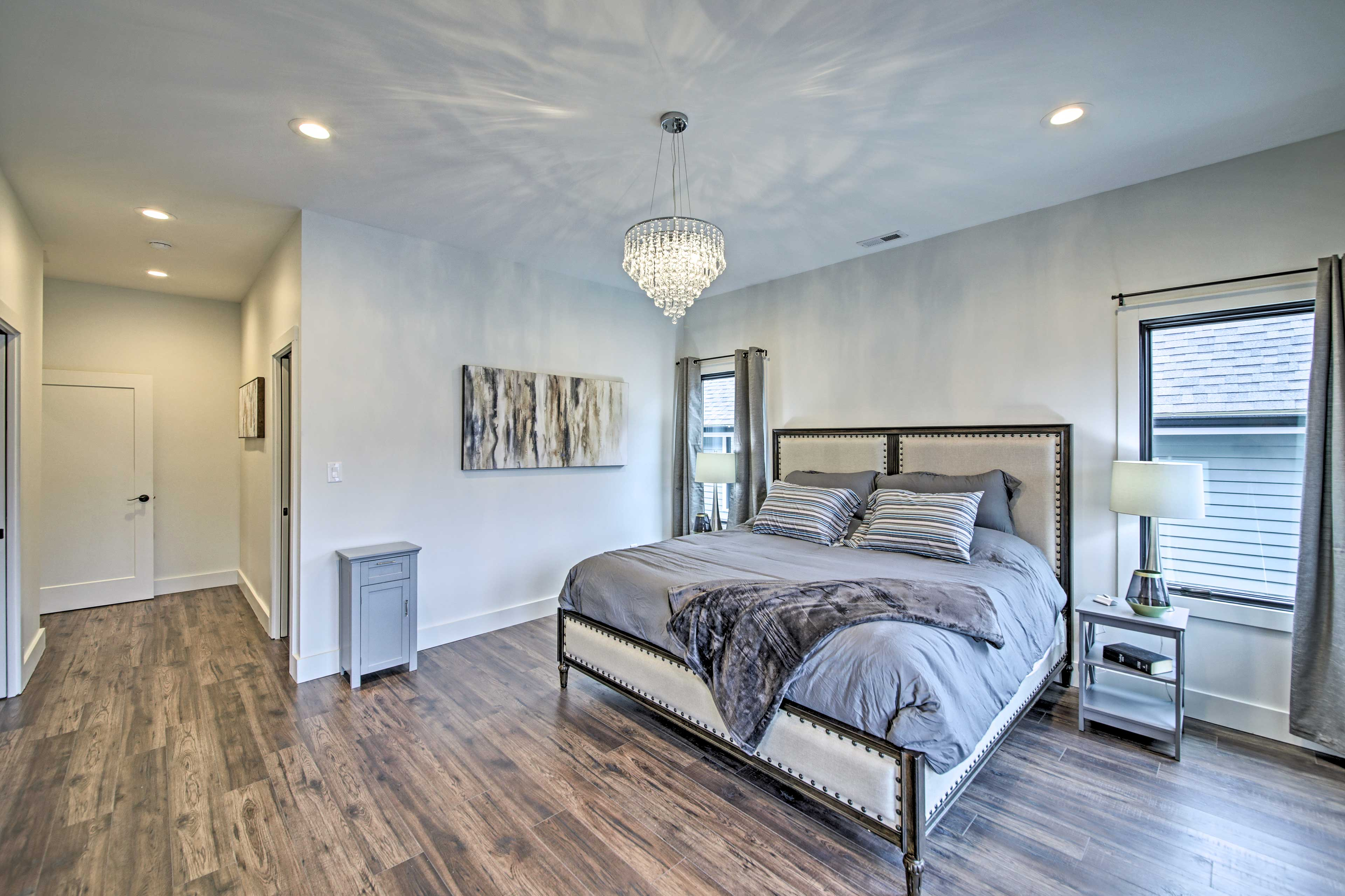 The master bedroom boasts a king bed.