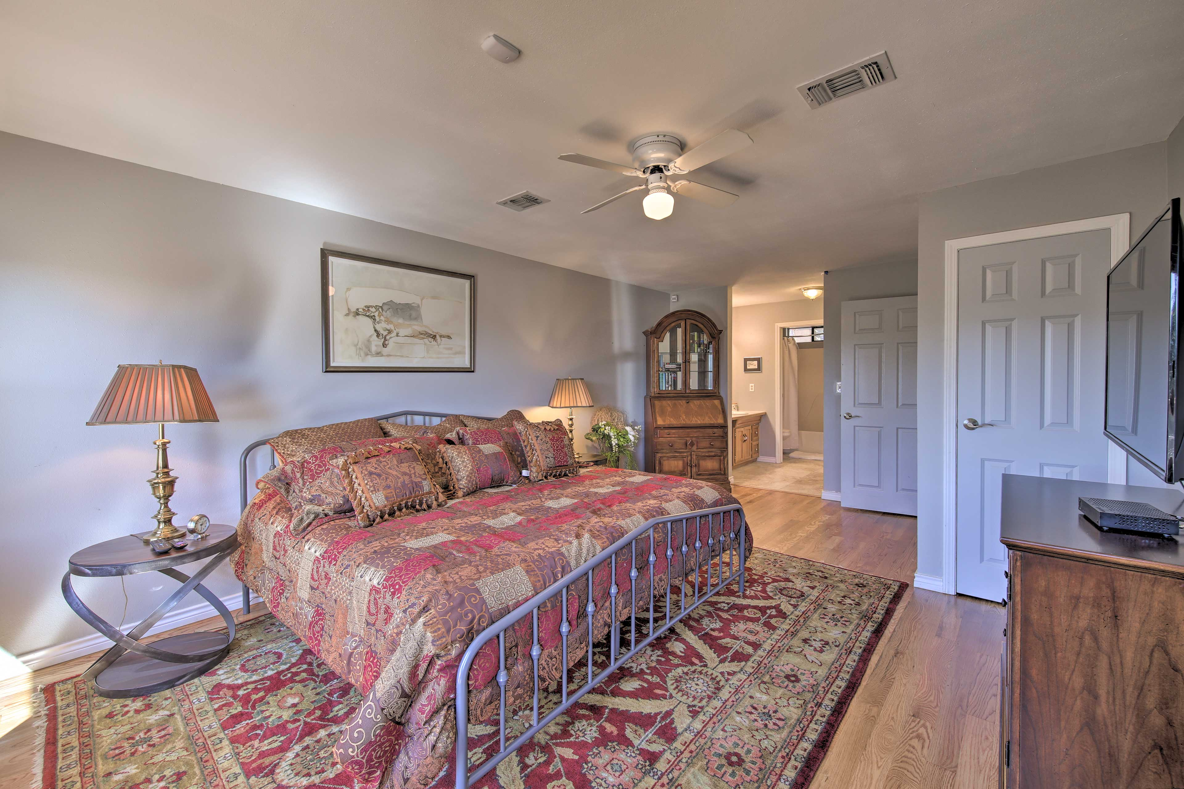 The second master bedroom has a king-sized bed.