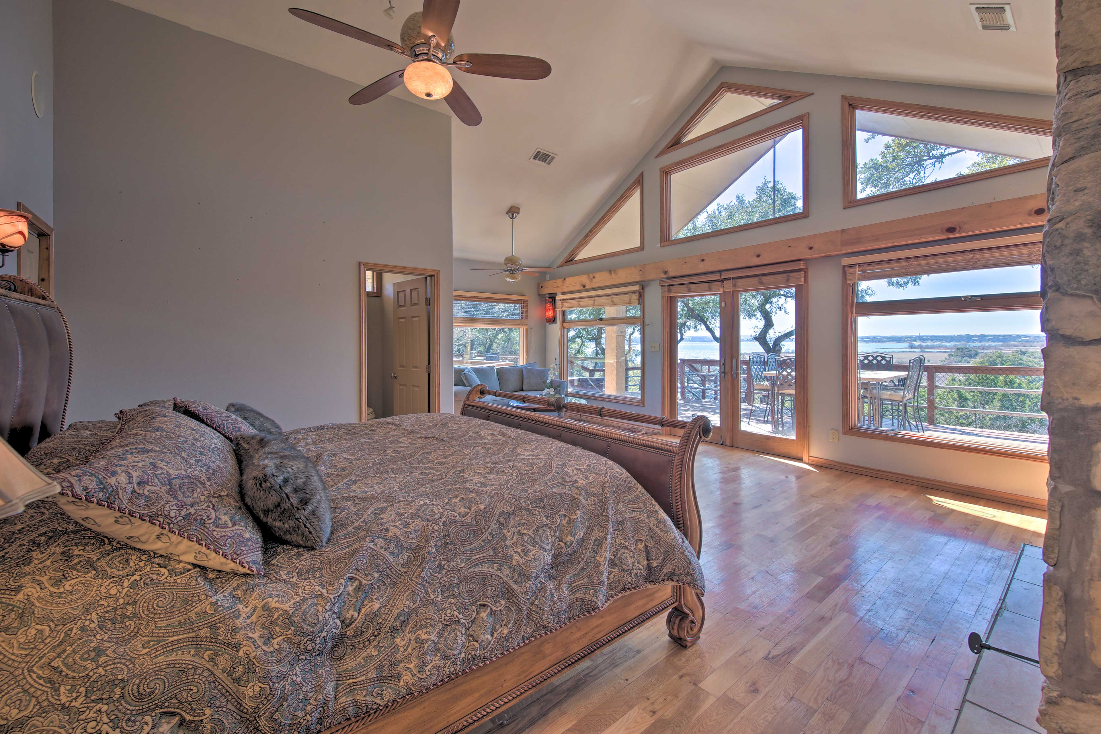 The master suite features natural light and cathedral ceilings.