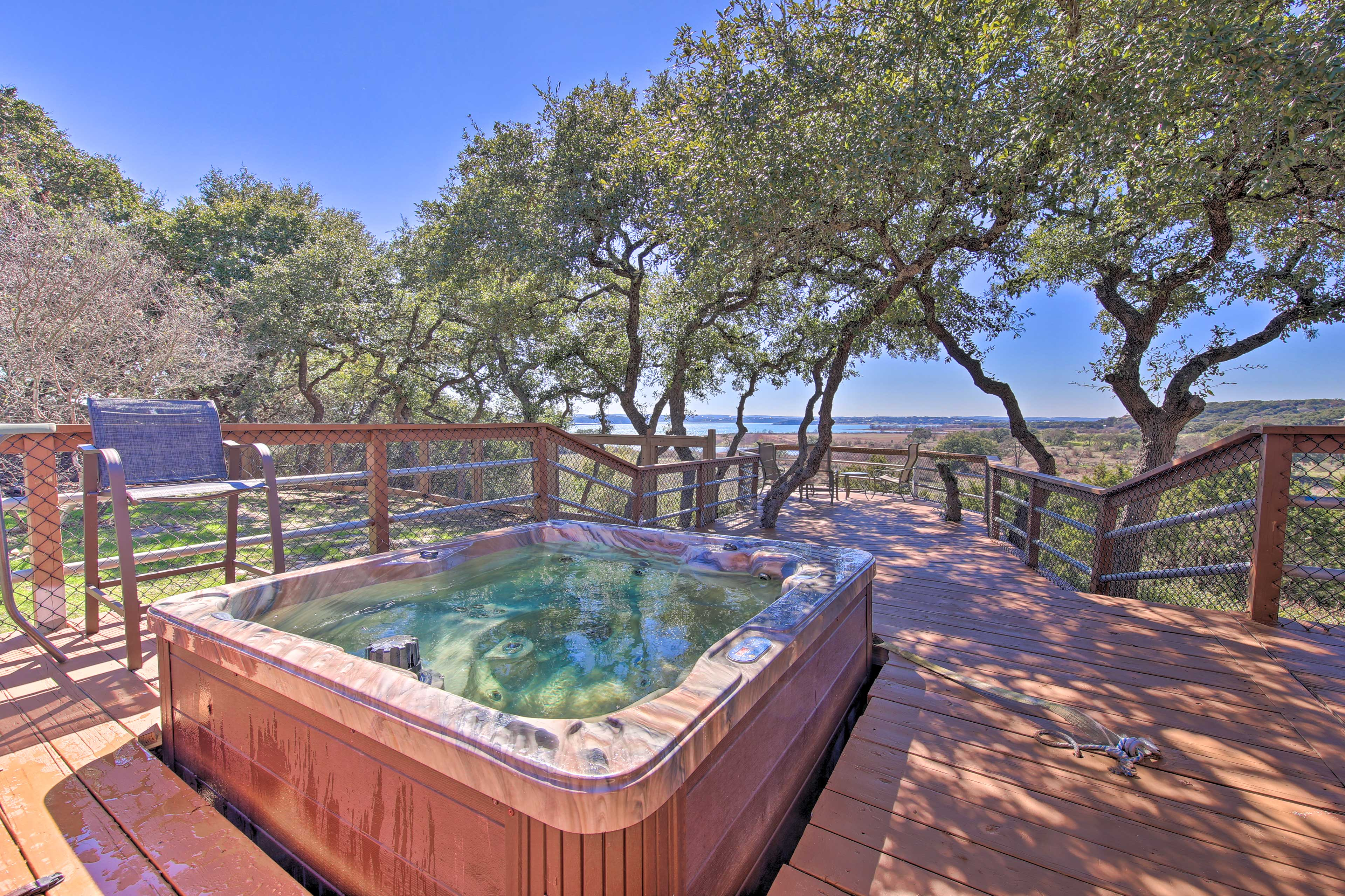 Outdoor amenities include a gorgeous hot tub.