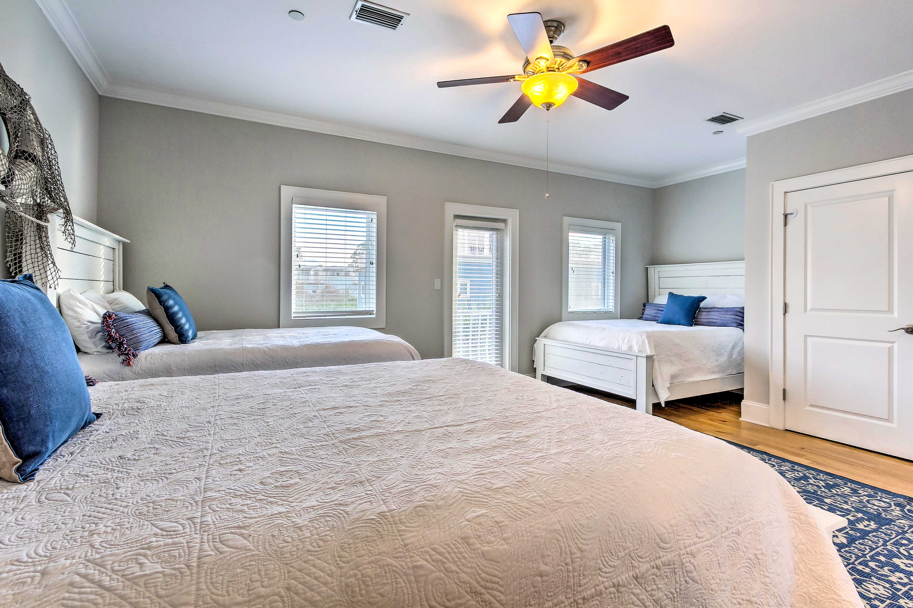 With 3 full beds, this room is great for kids or several couples.