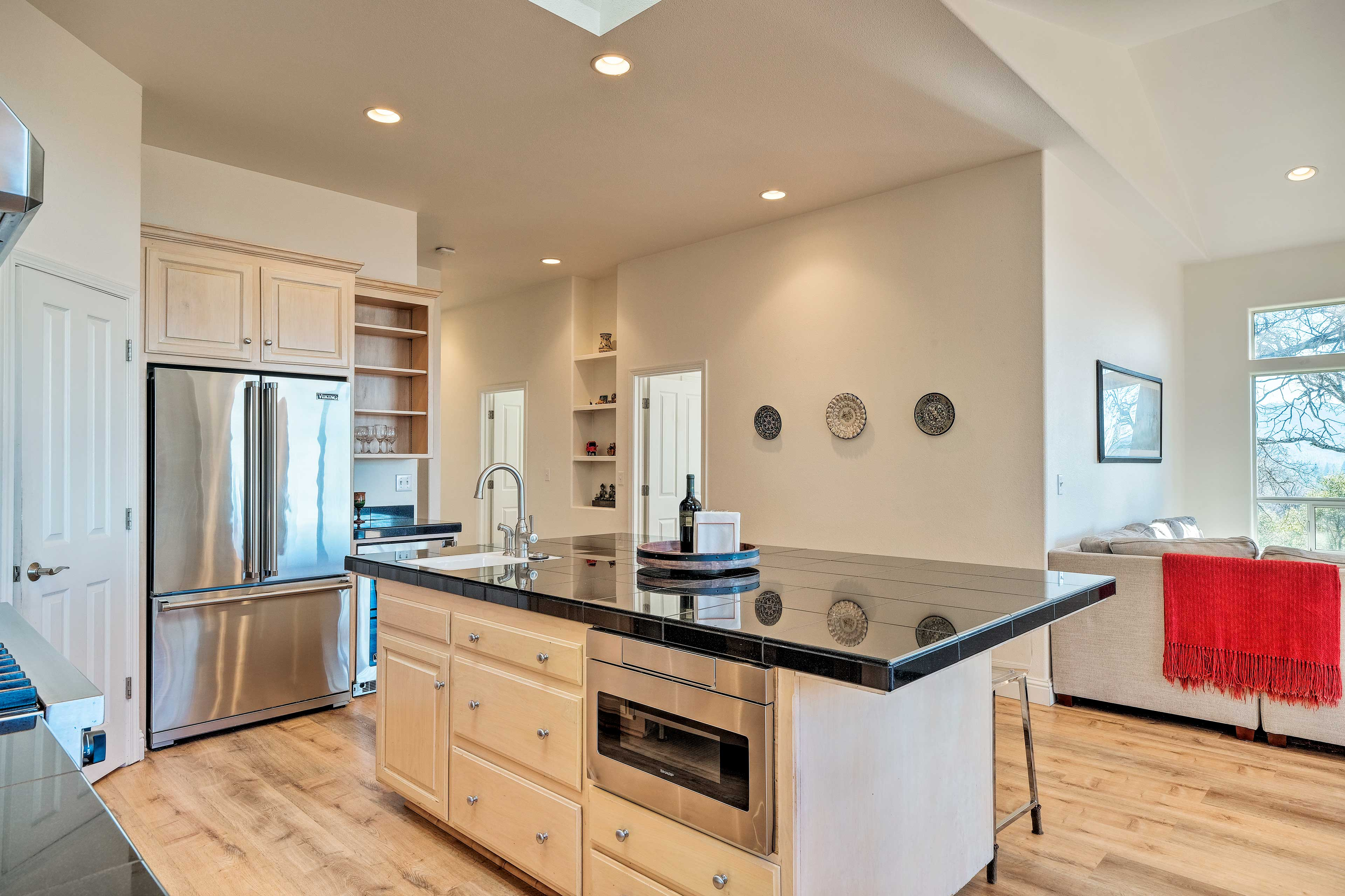 The kitchen area opens up seamlessly into the living room.