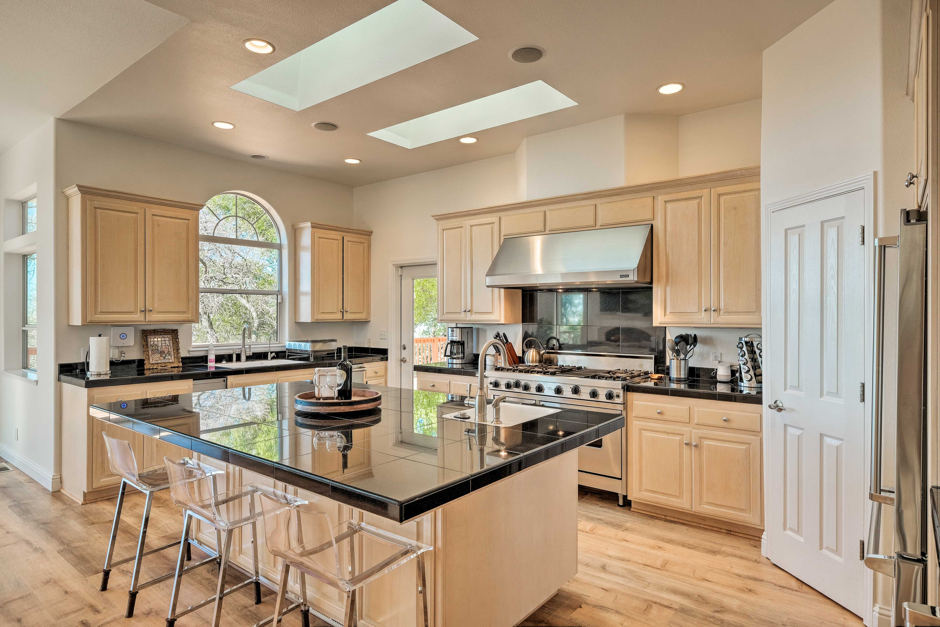 High-end appliances complete the fully equipped kitchen.