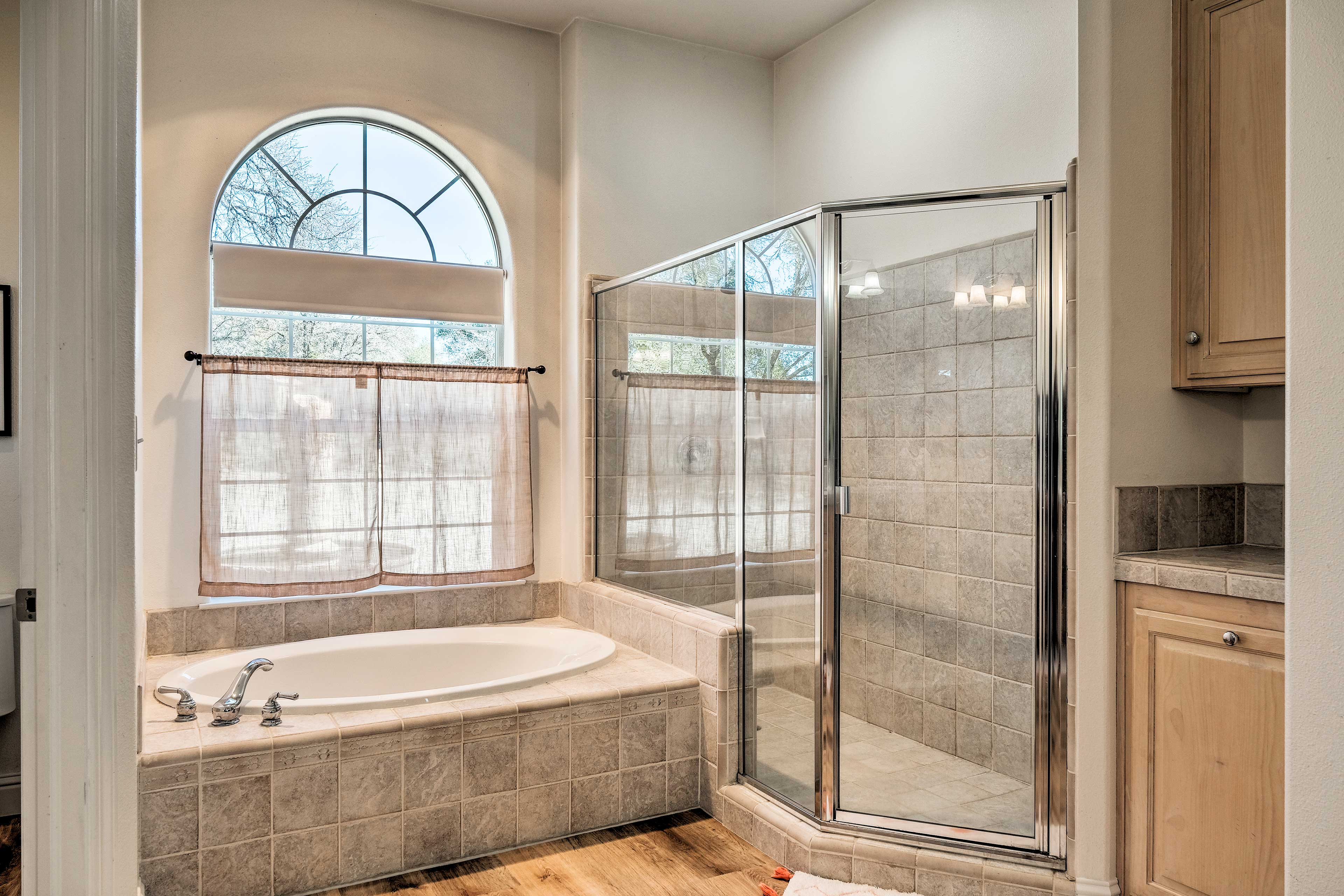 Indulge with an evening soak in the master bathroom's tub.