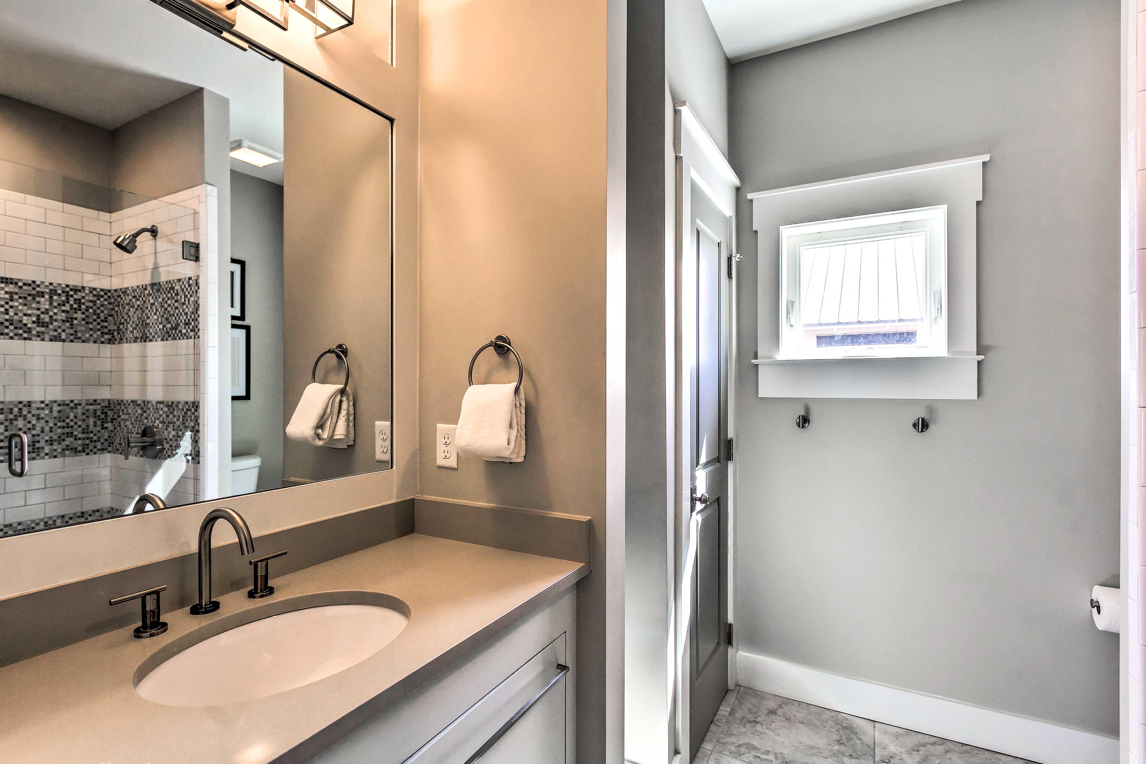 The home provides 5 full bathrooms & 1 half bath.