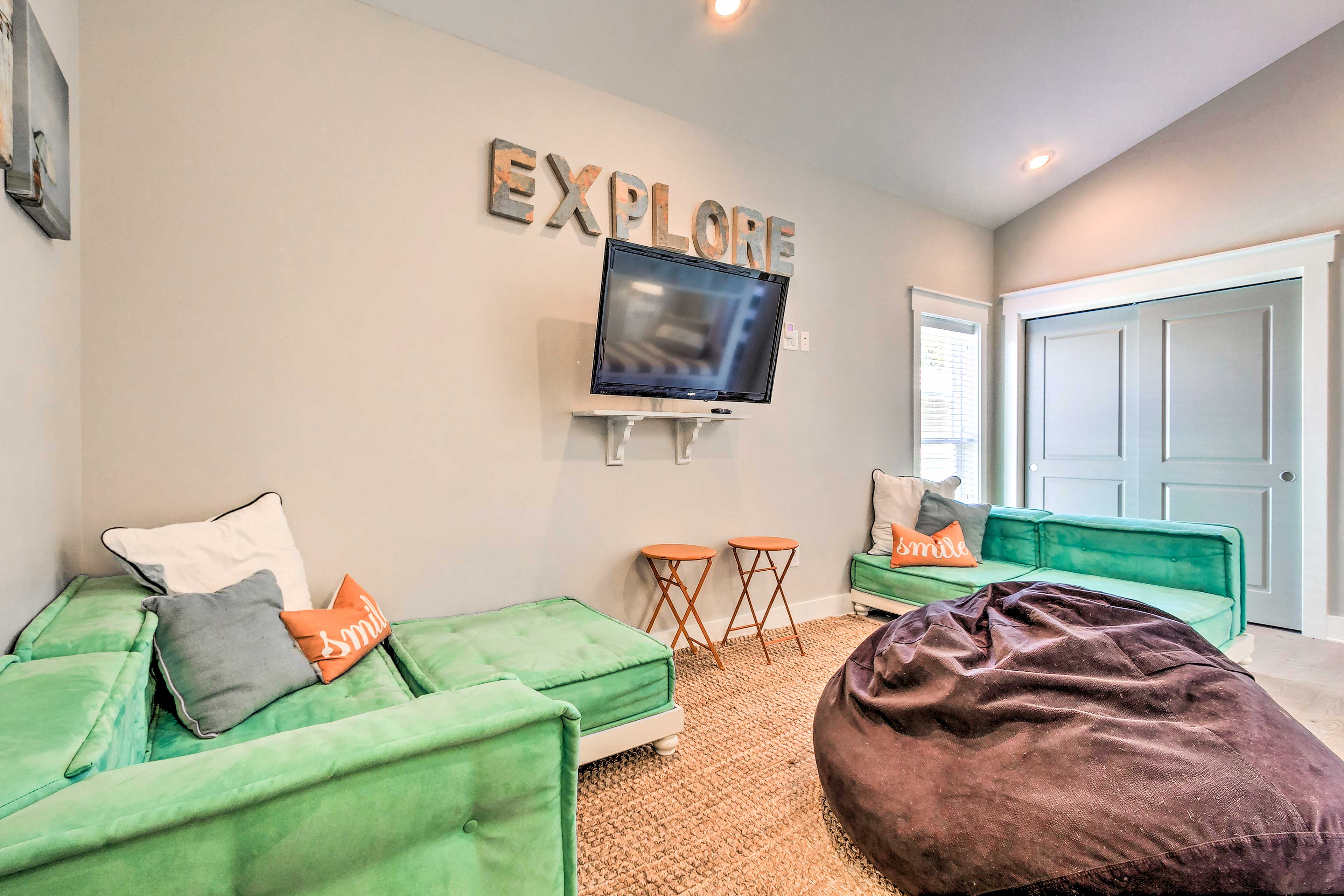 Explore this kid-friendly corner of the home, complete w/ a beanbag chair & TV!