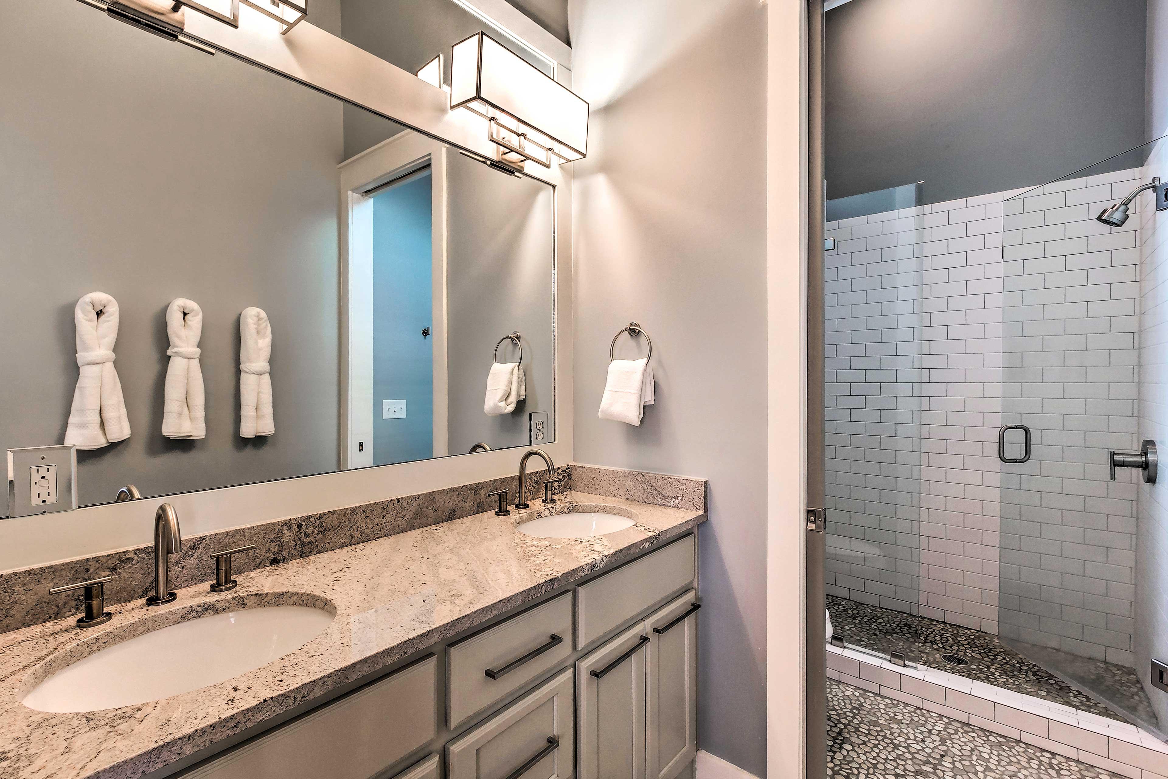 Barn doors reveal the en-suite bath.
