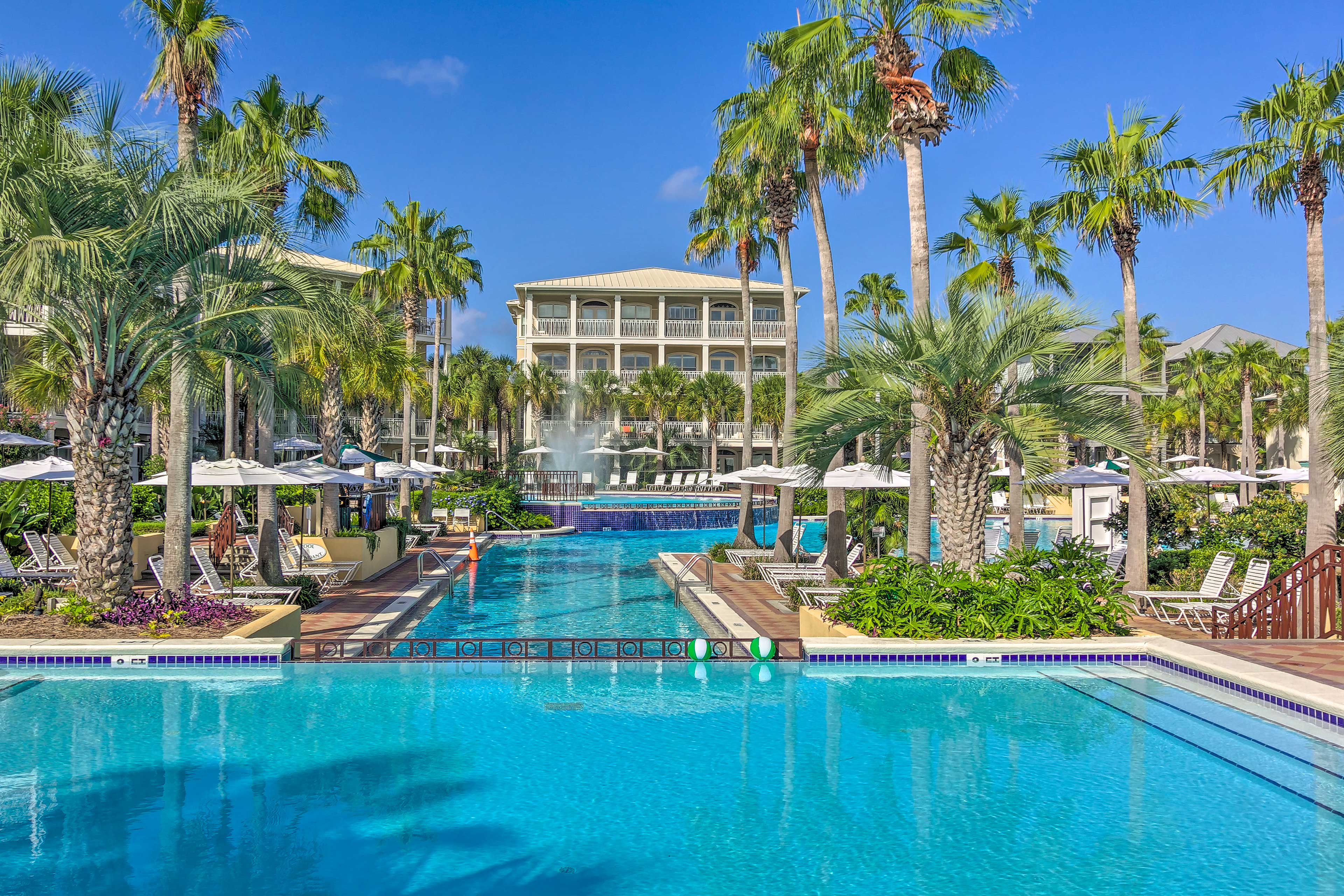 This expansive pool area features multiple lounge areas.
