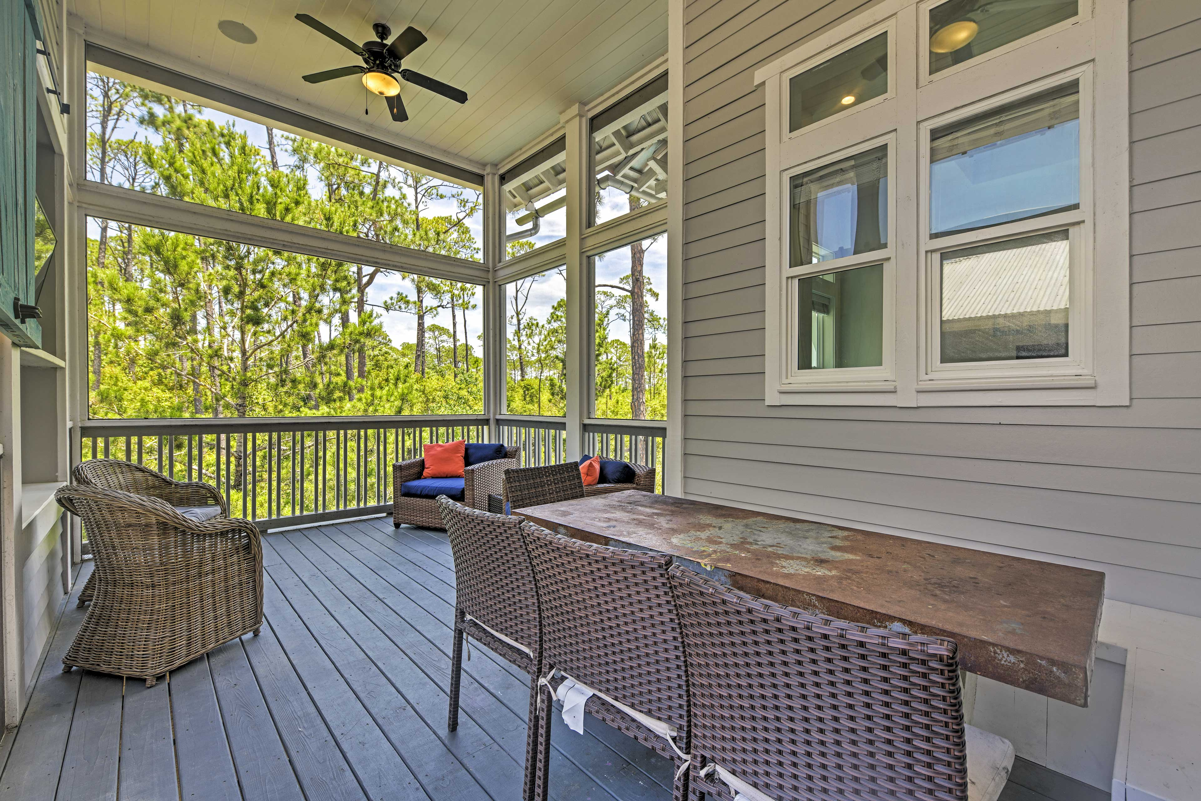 Step out to the enclosed sunroom for Barn doors slide over to reveal a Smart TV.
