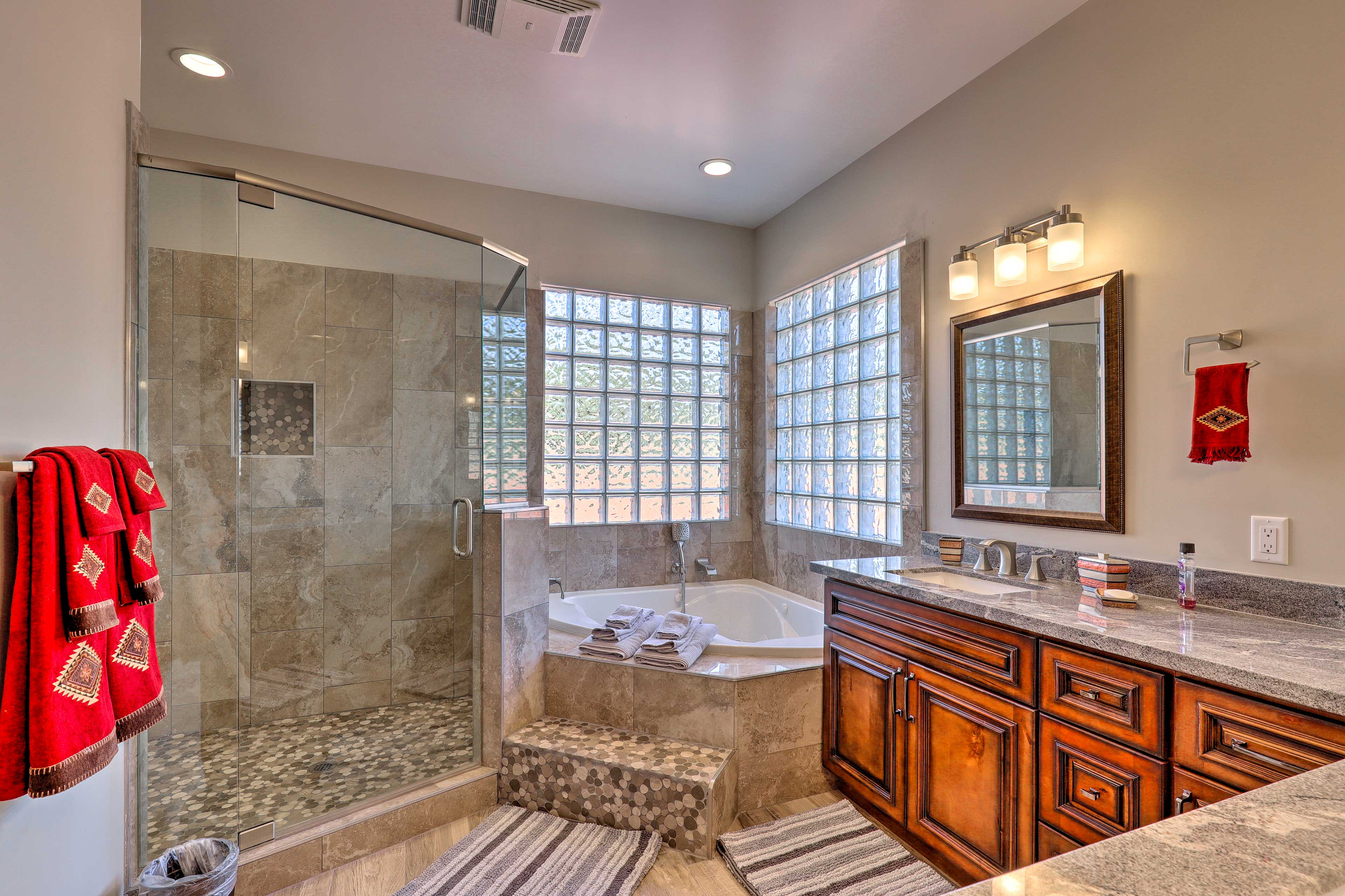 Take a relaxing soak in the master bathroom.