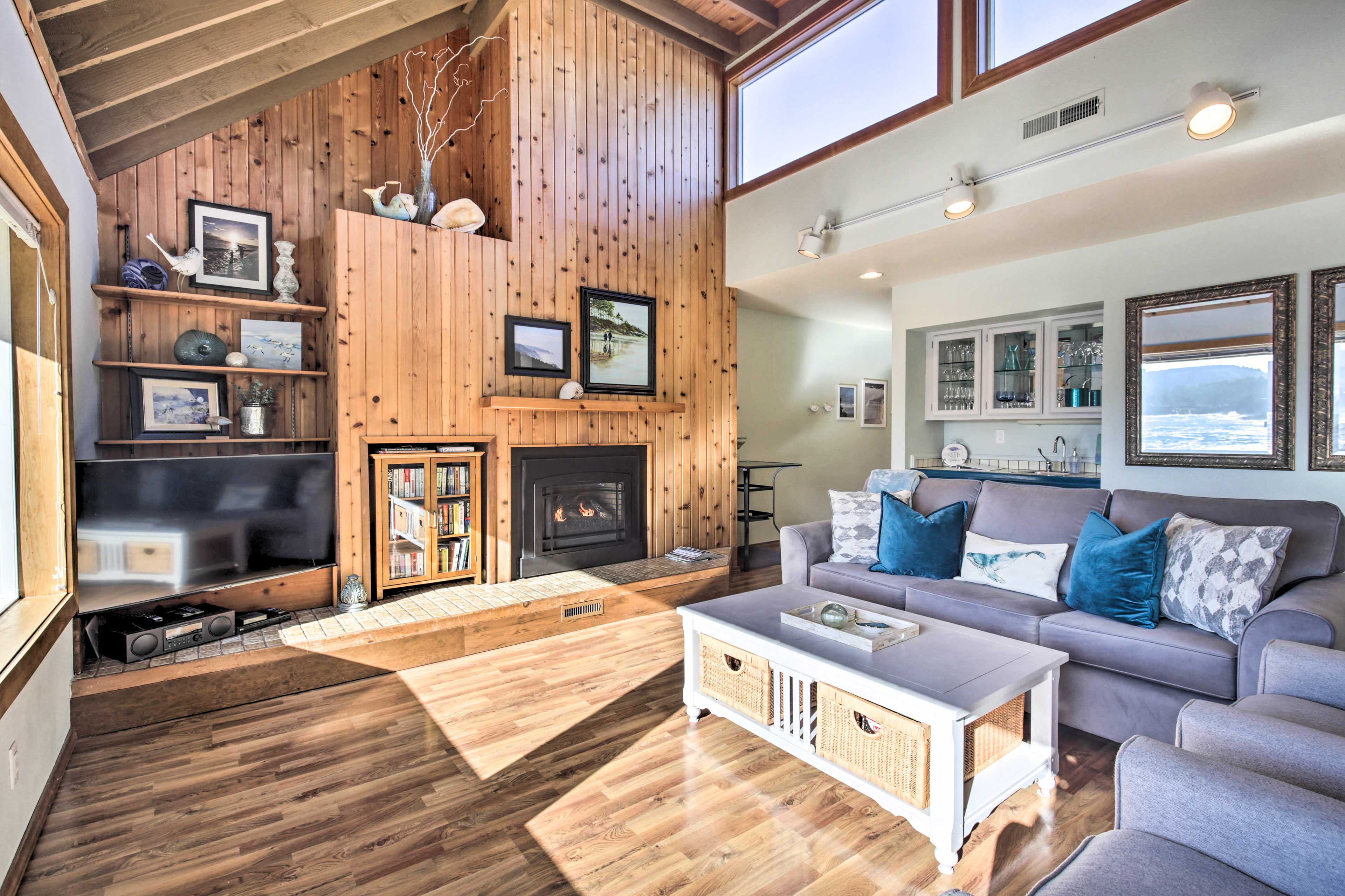 The bright living space features hardwood floors and high ceilings.
