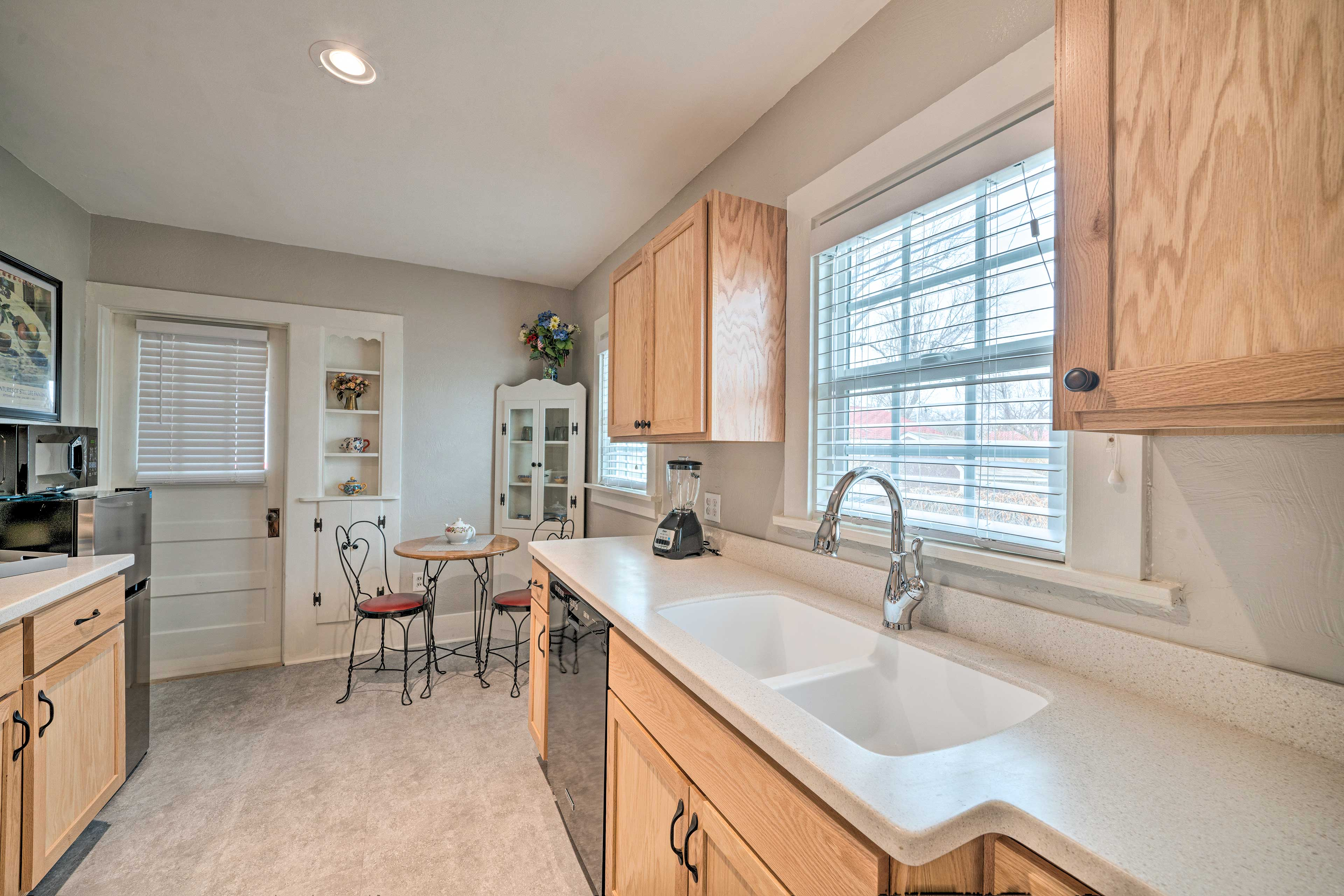 This kitchen offers ample counter space and modern amenities for your comfort.