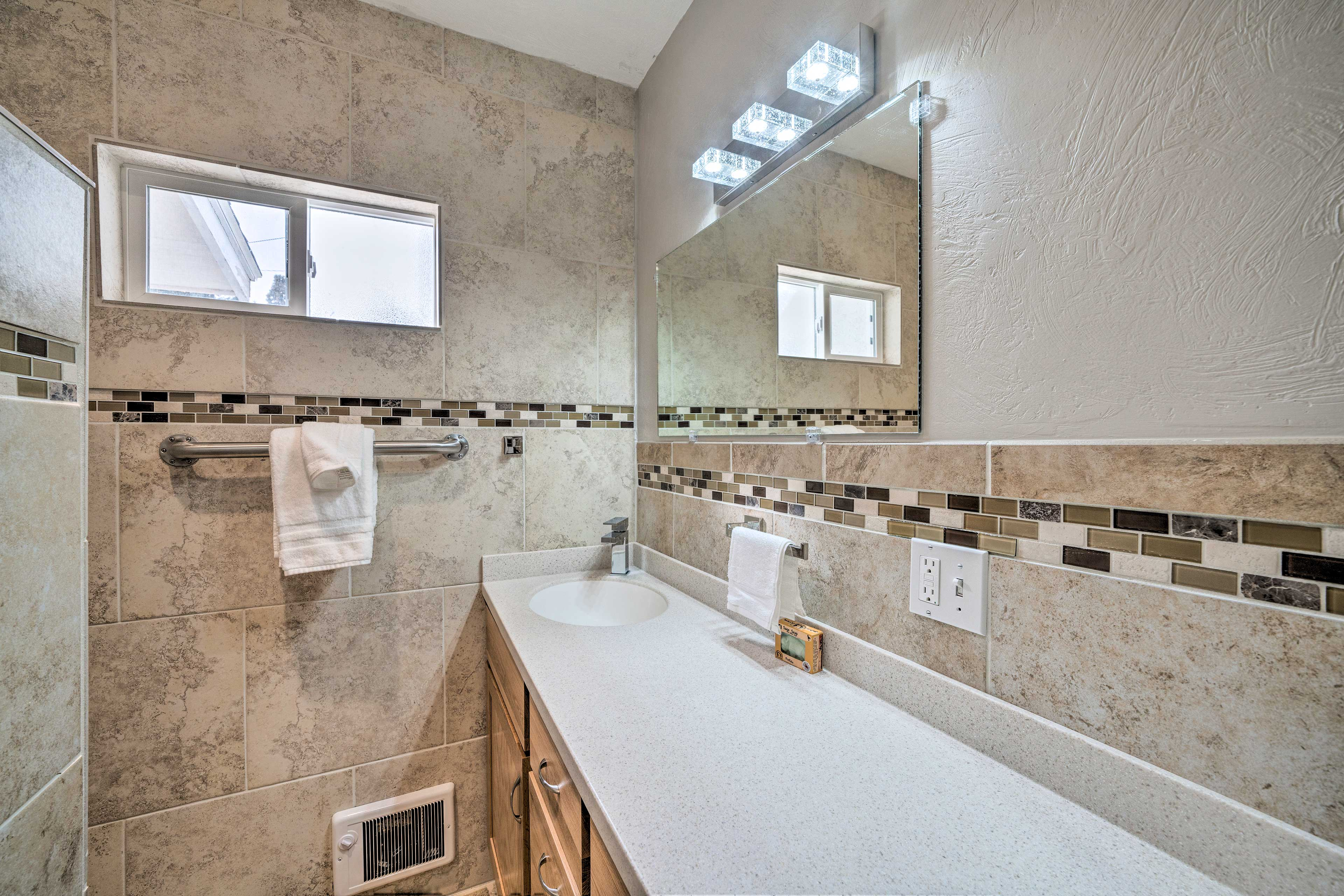 There's enough bathroom counter space for all of your things - and his!