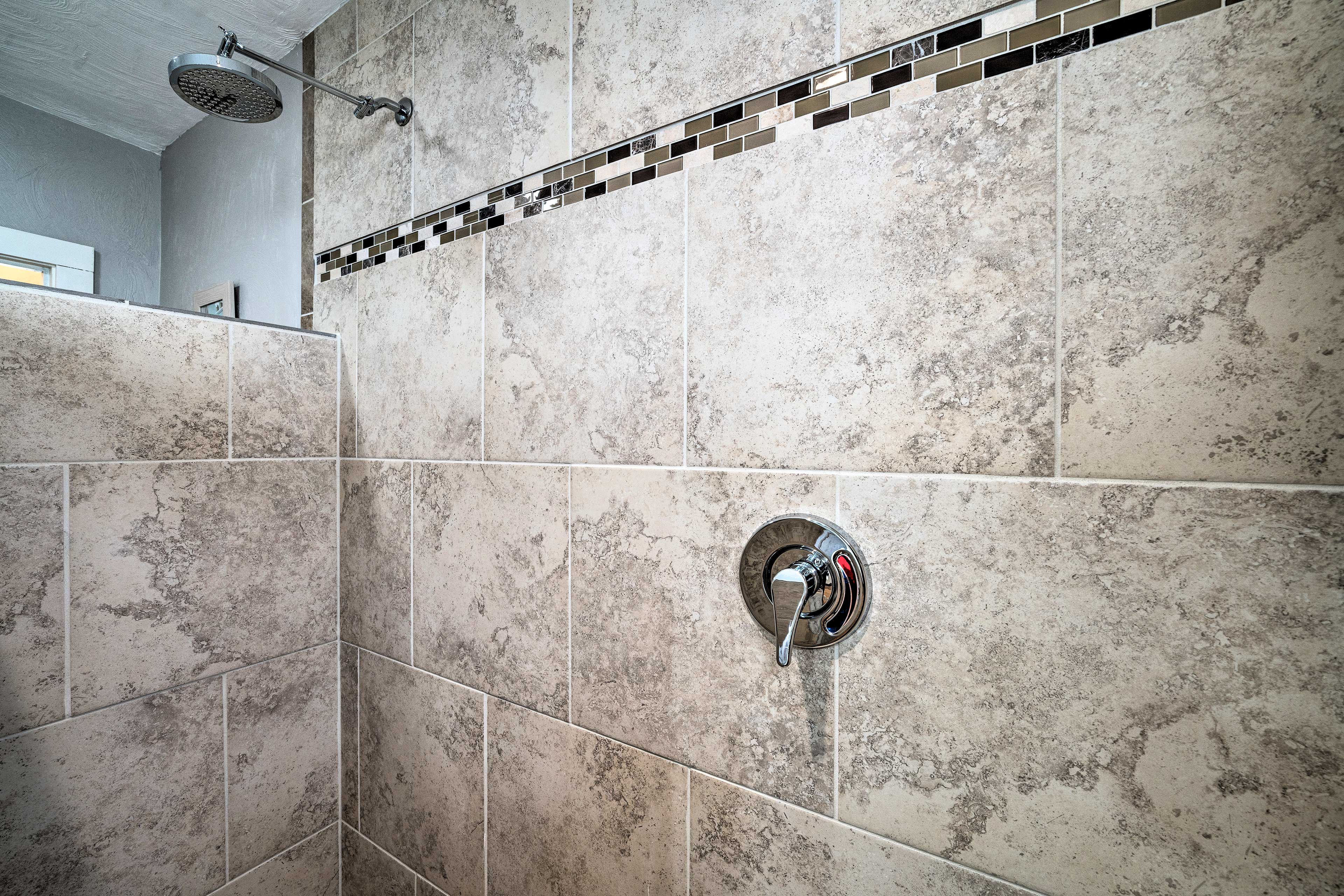 The rainfall shower head is a luxurious way to rinse off after a day outside.