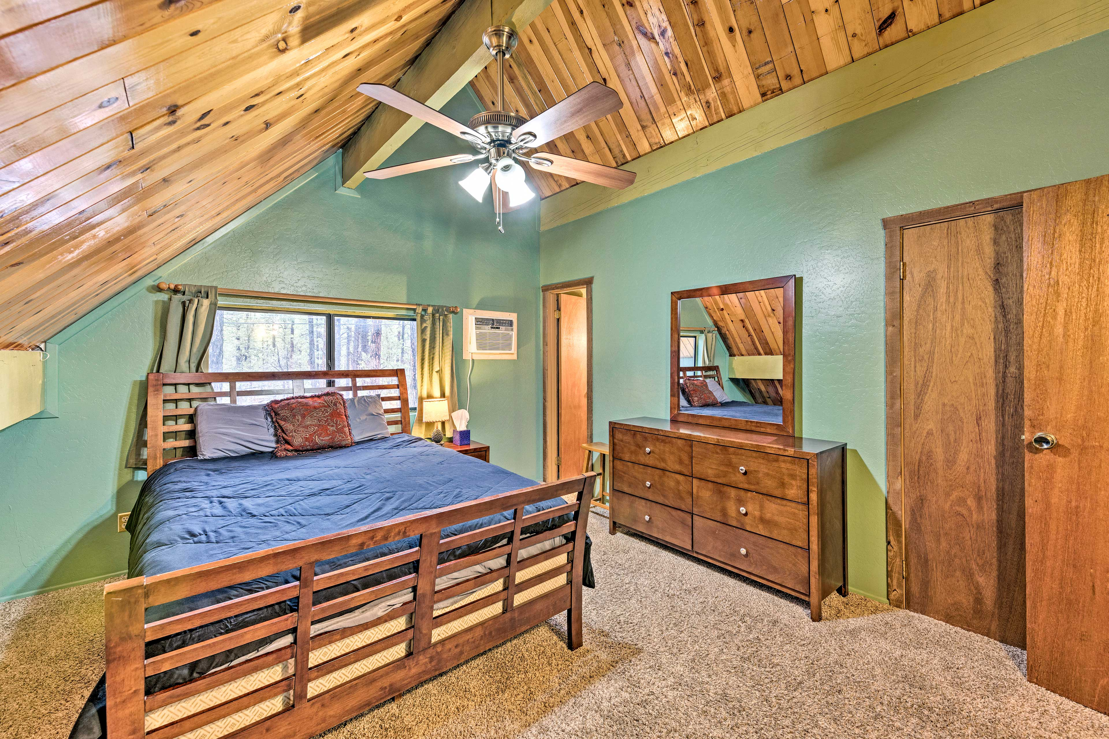 Another rustic bedroom can be found off the loft.