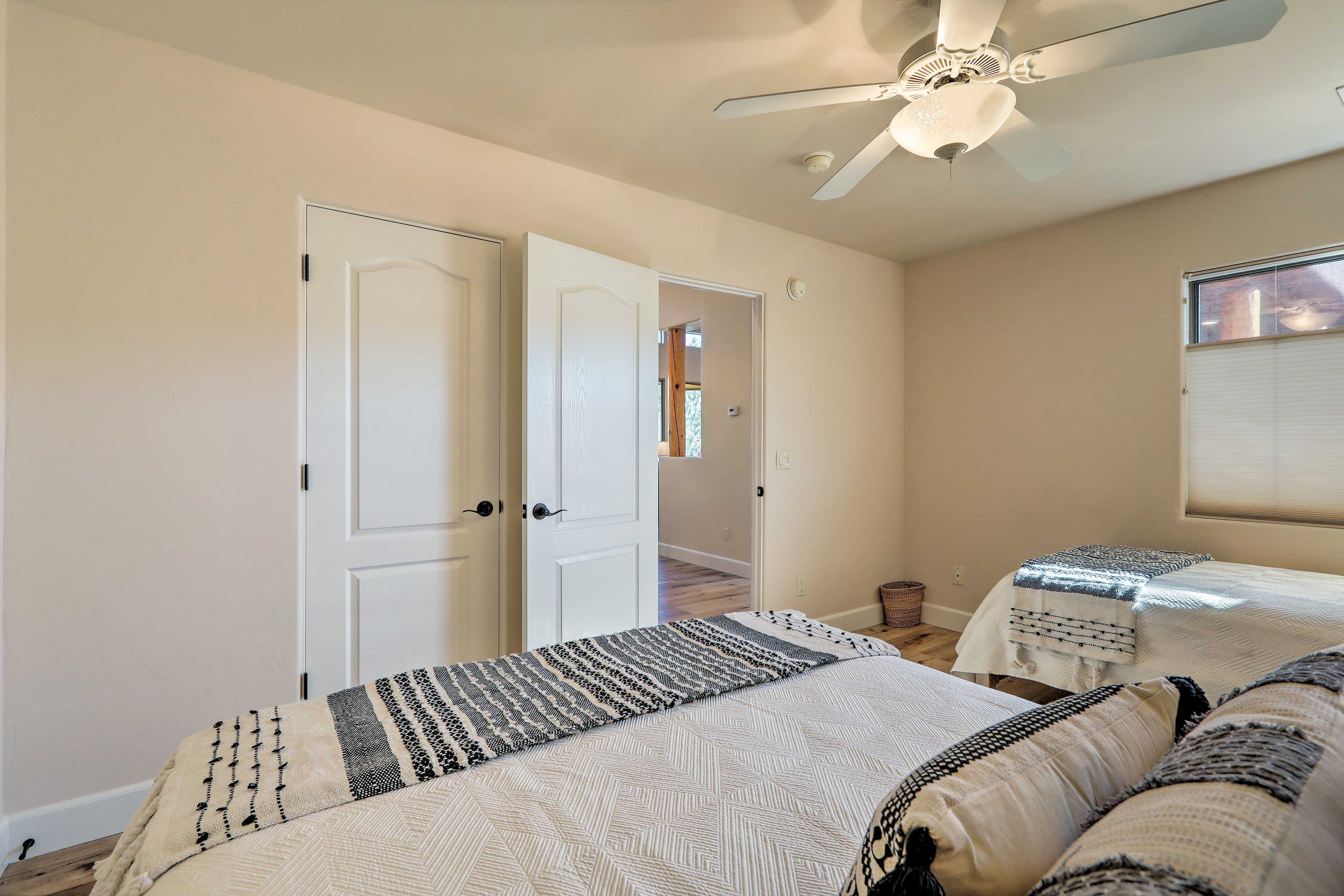 It features a queen bed, twin bed, and ample storage space.