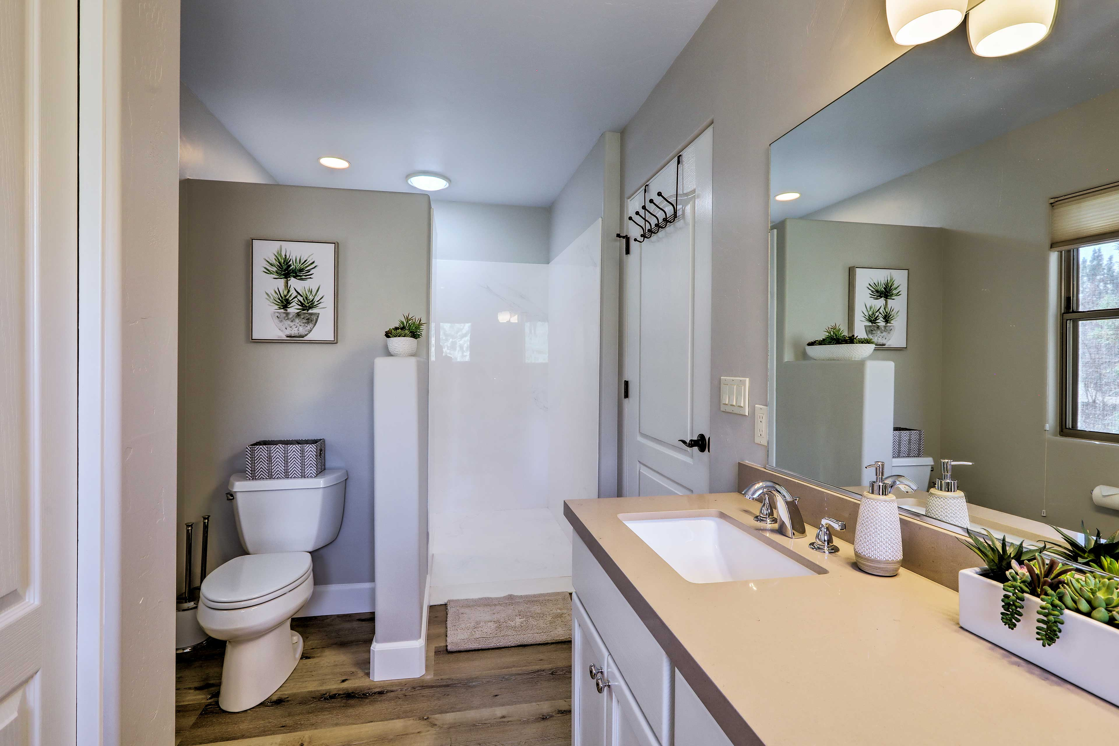 The master bath features both a walk-in shower and soaking tub.