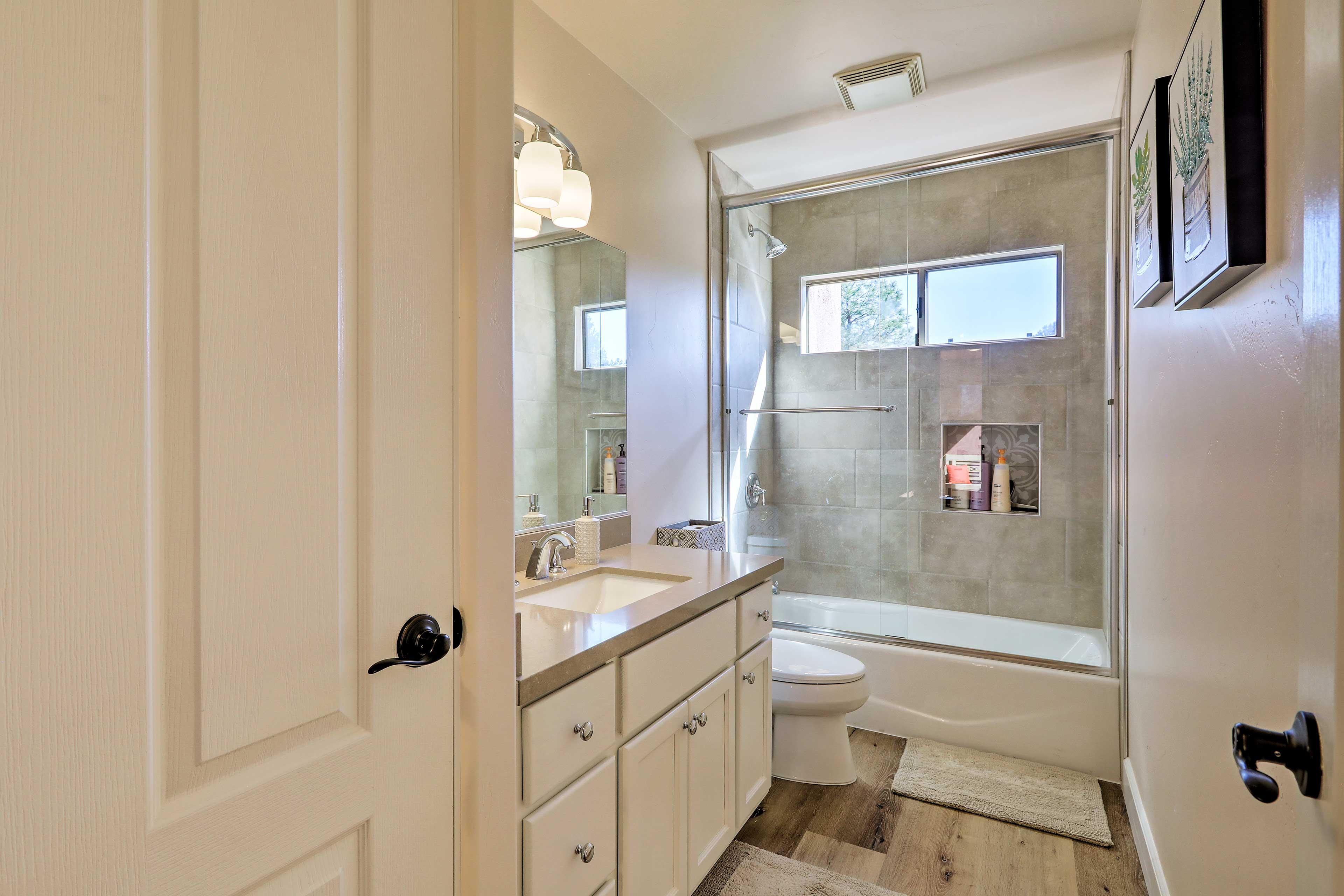 Natural light illuminates this pristine bathroom.