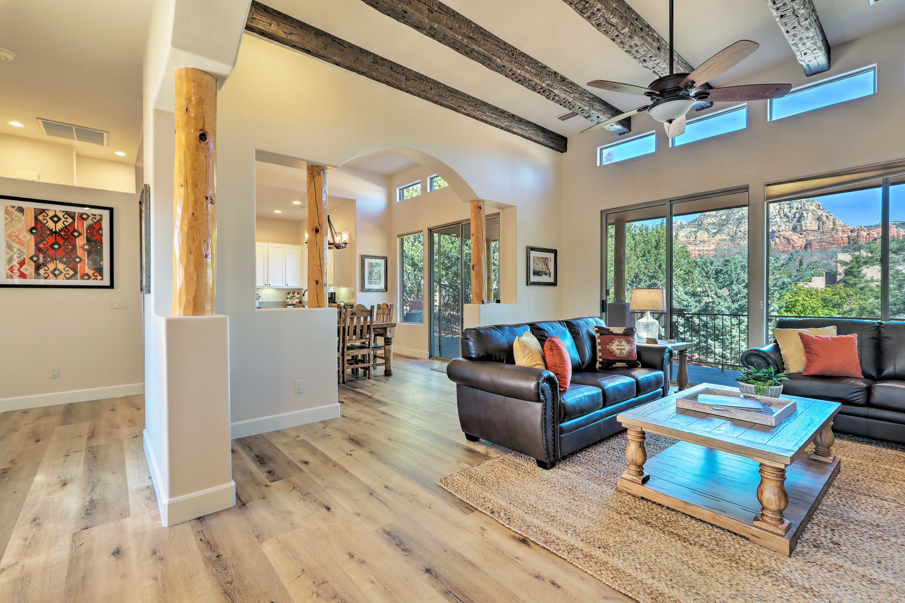 Inside the home, crisp white walls perfectly contrast rustic wood beams.