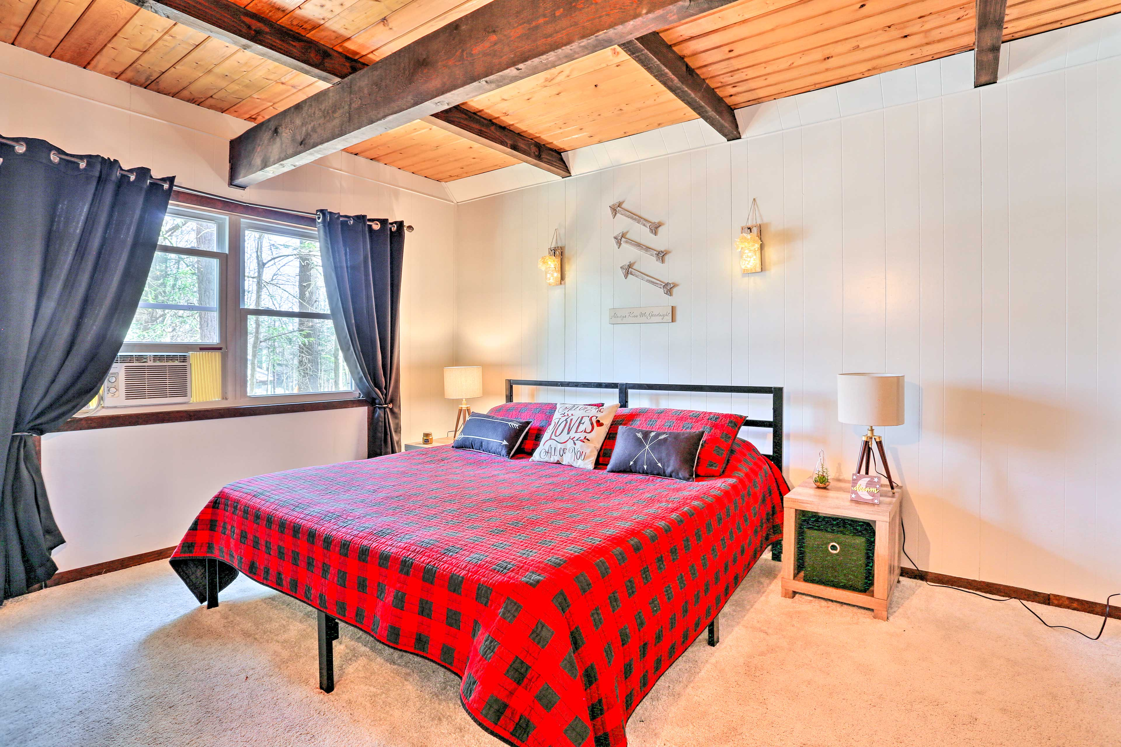 Couples will love this cabin-inspired master bedroom!
