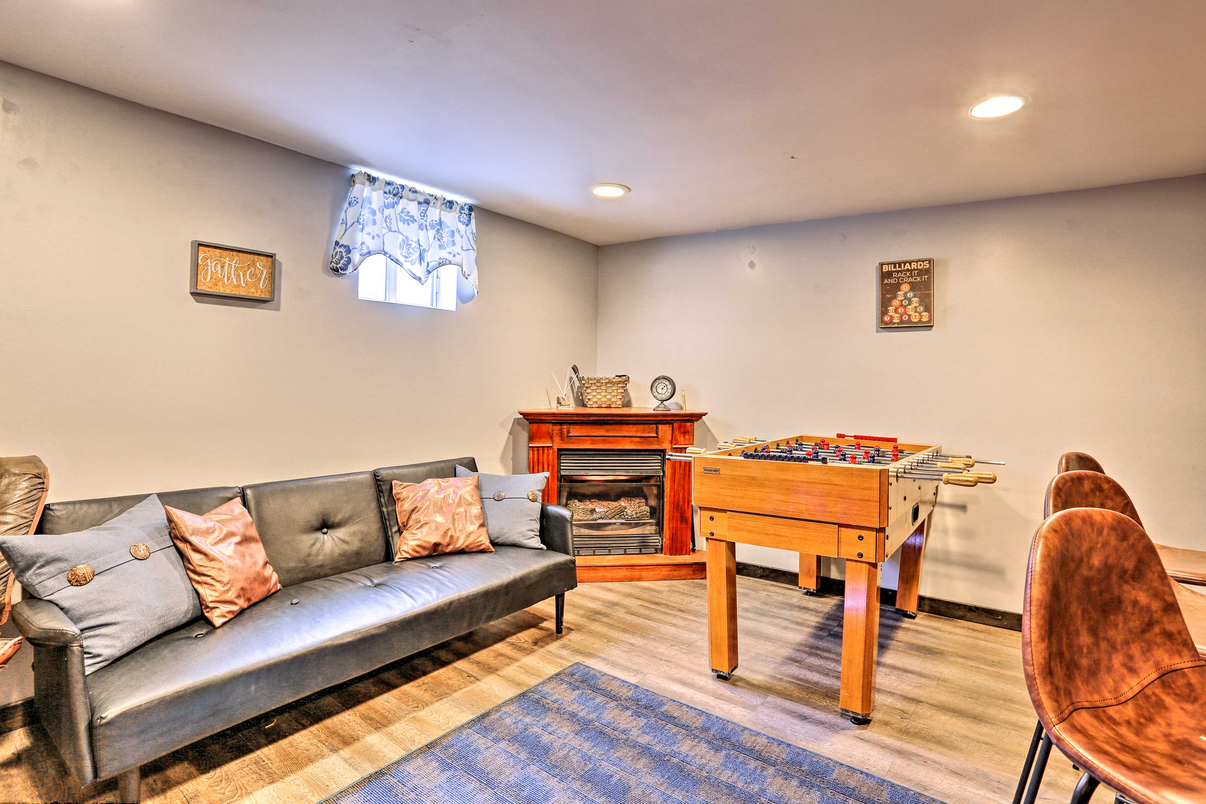Spend all day reading by the basement fireplace.