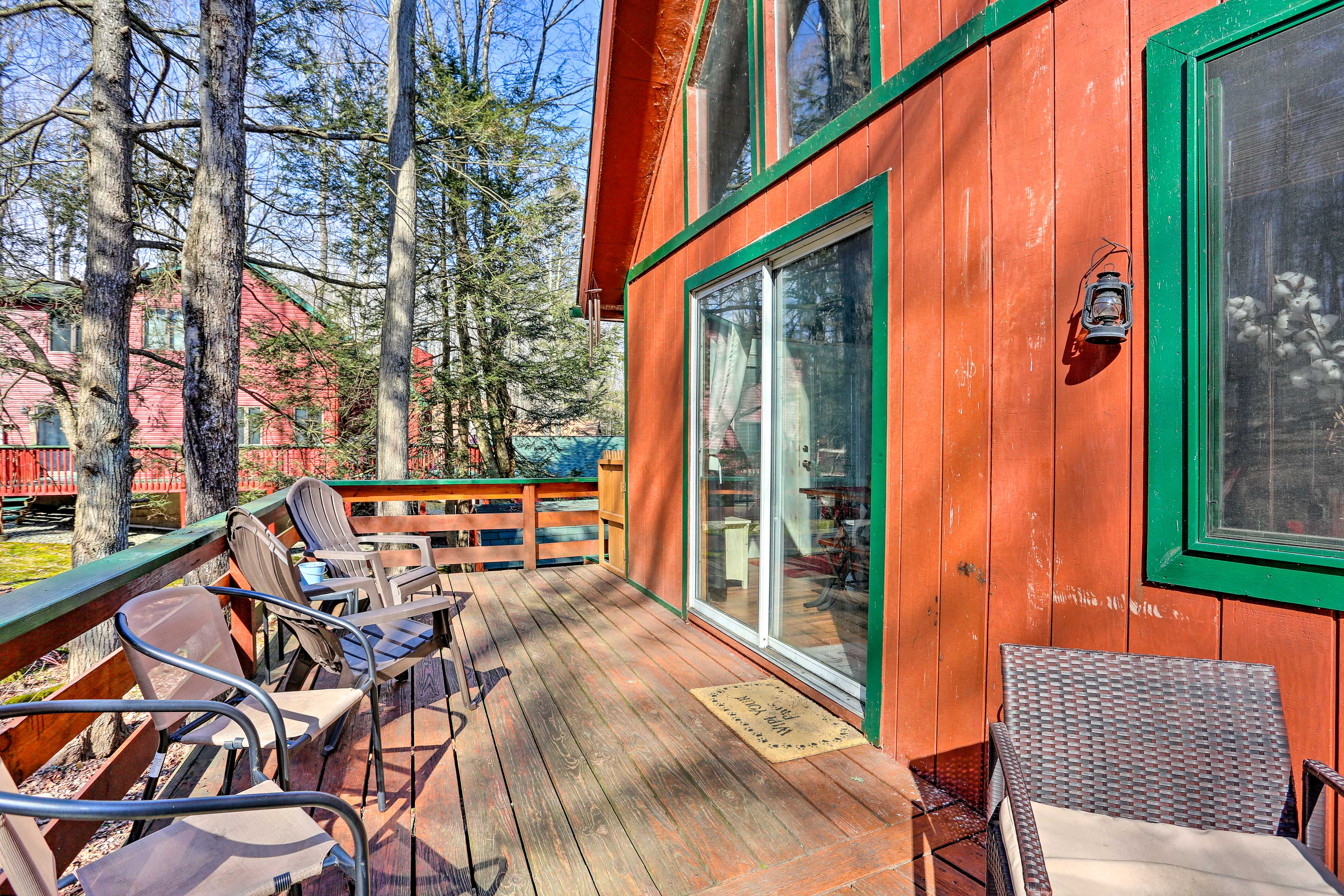 Breathe in the crisp forest air as you step onto the deck.