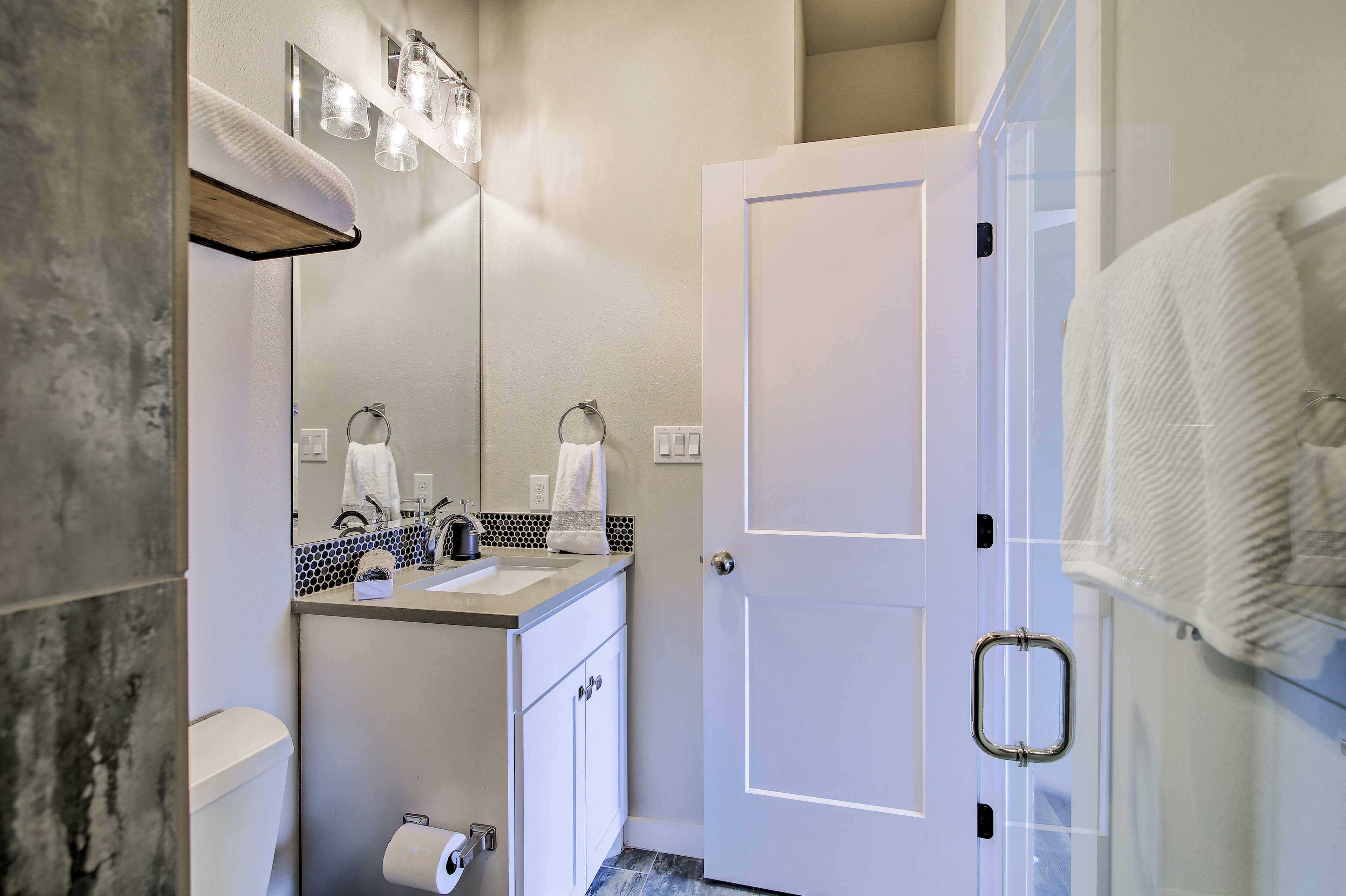Rinse away the day in the tile-lined stand-up shower.