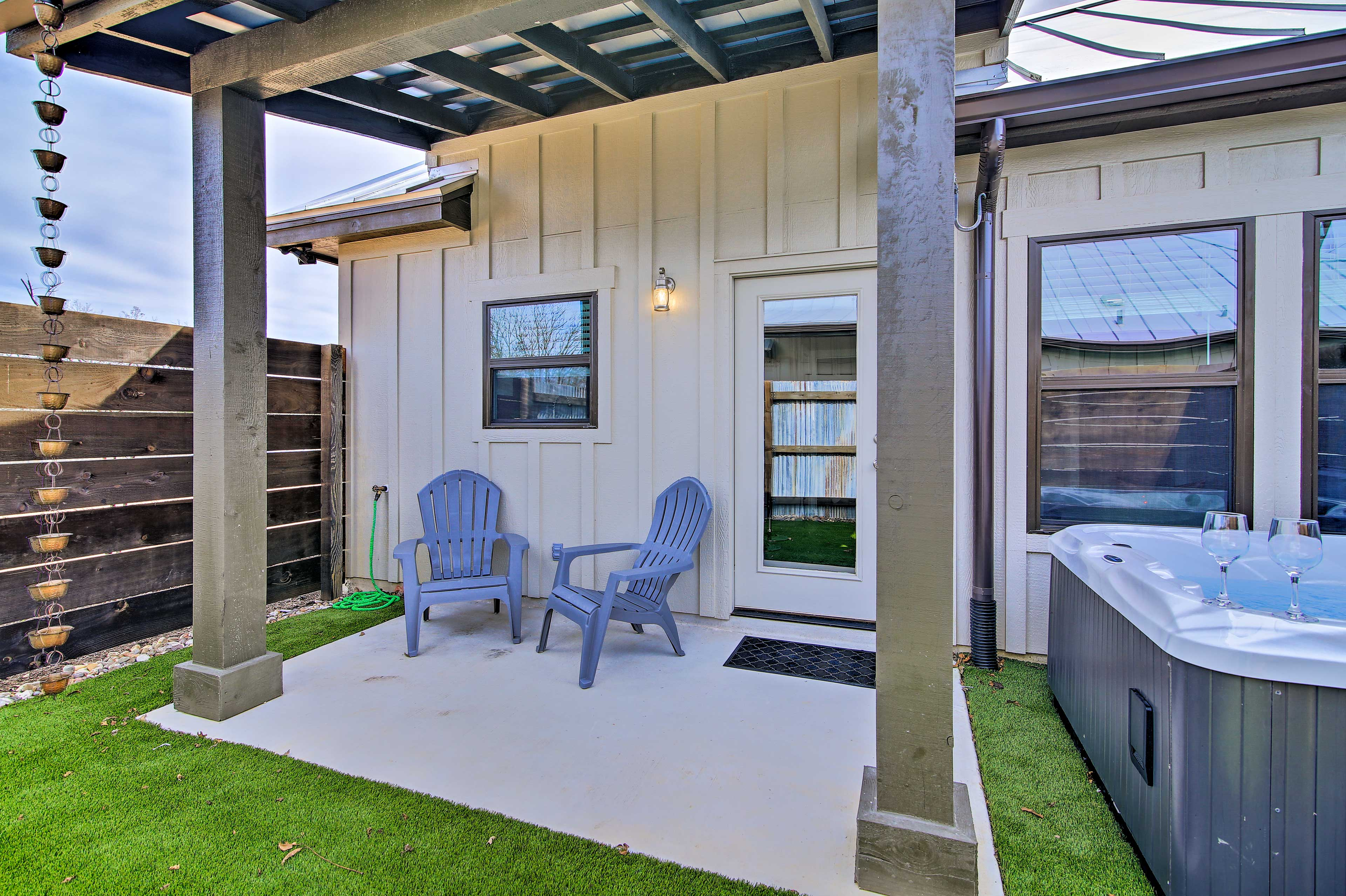 Step onto the covered patio and enjoy your morning cup of coffee.
