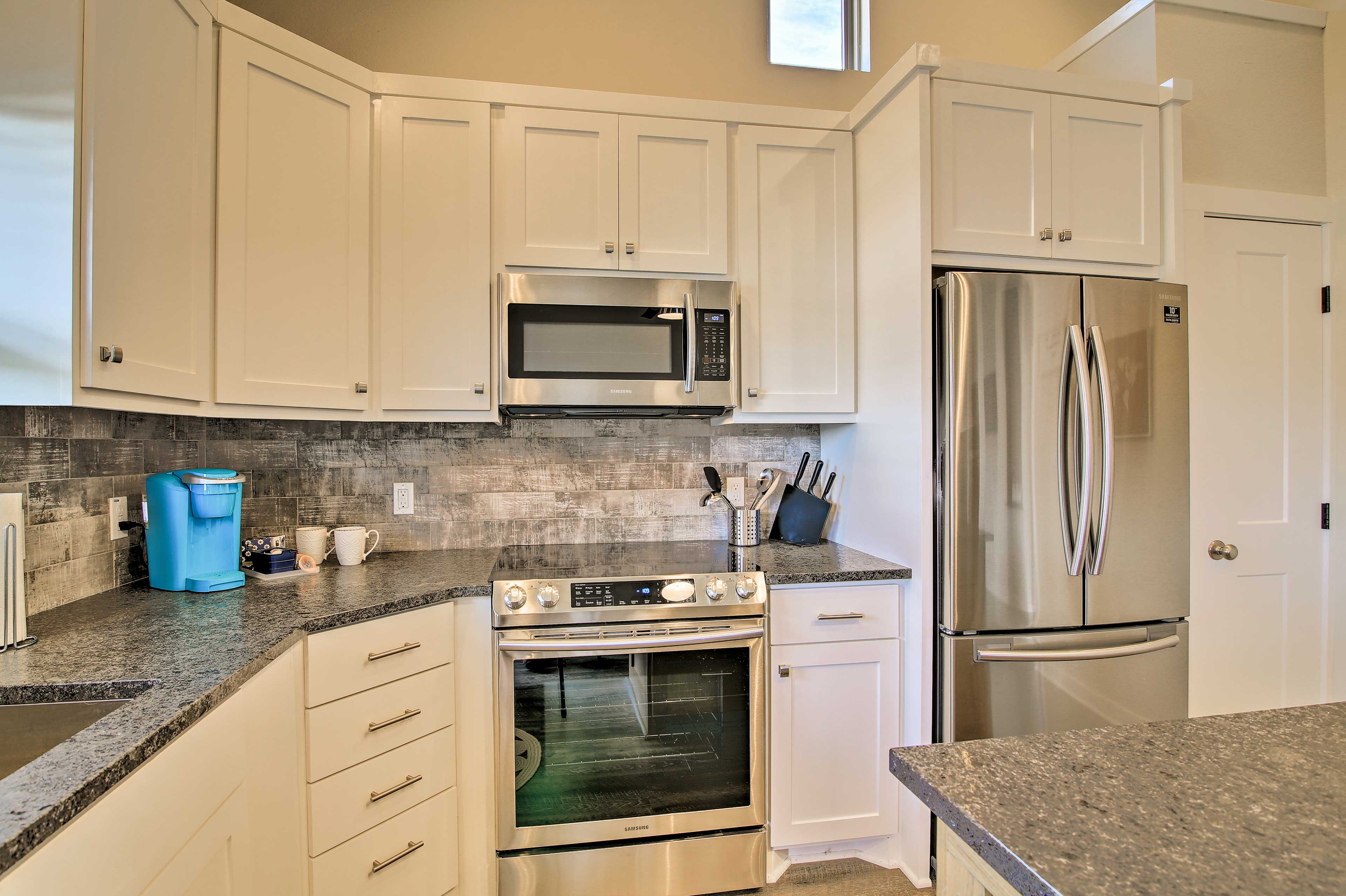 You'll have plenty of stainless steel appliances and cooking utensils.